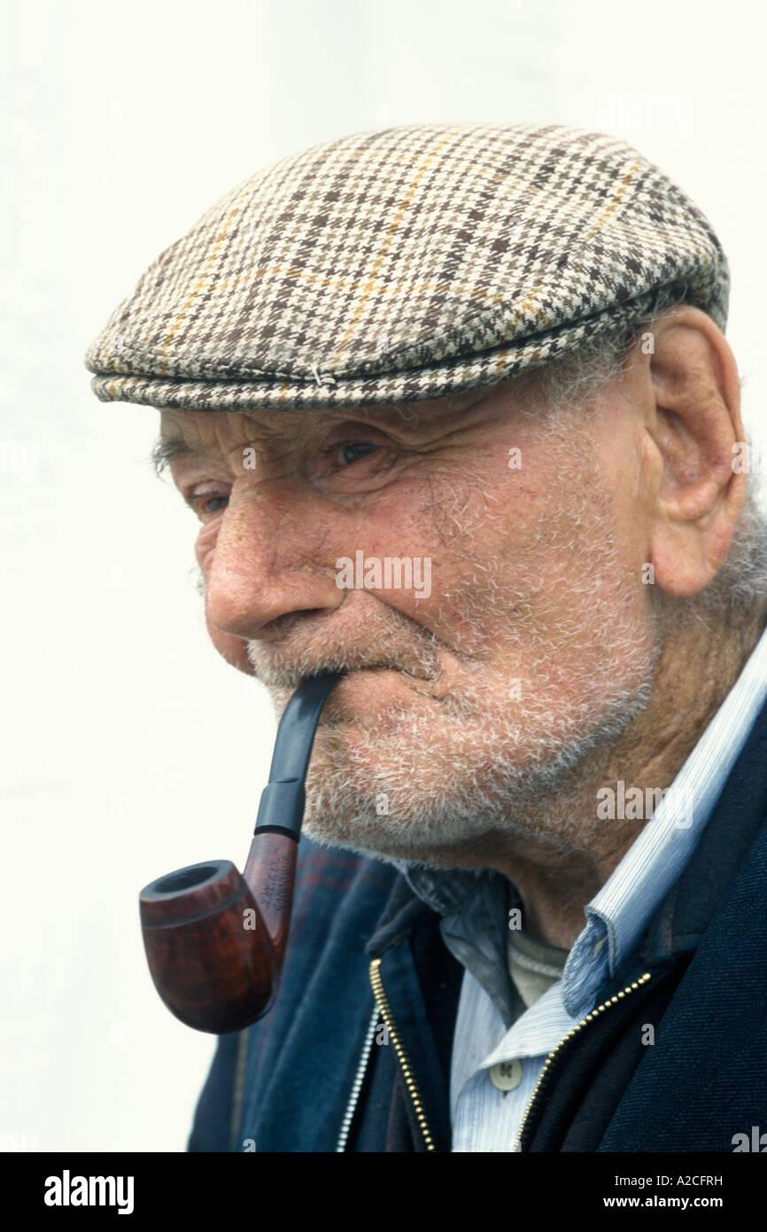 Man Pipe Smoking Cap Stock Photos   Man Pipe Smoking Cap Stock ... 7fa37ea89c82