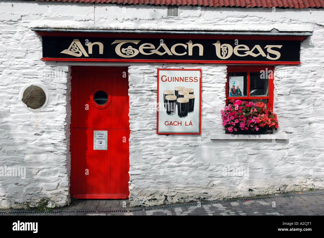 A Tiny Pub at Clonakilty Co Cork Ireland. The name over the door translates (The Little House) - Stock Image
