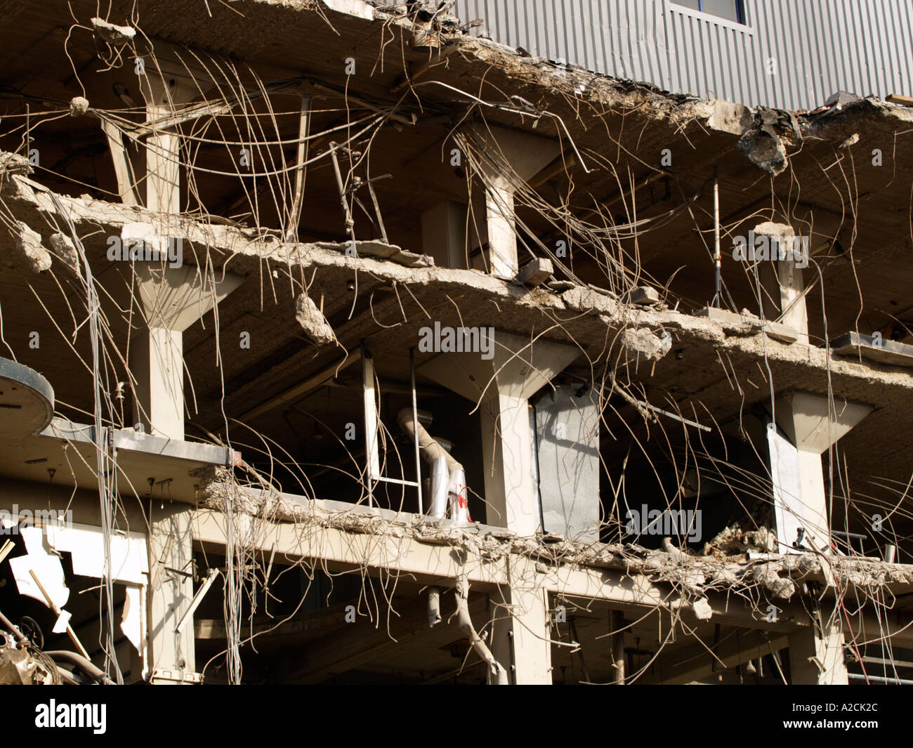 detail of a big industrial building being demolished showing that reinforced concrete was used during construction - Stock Image