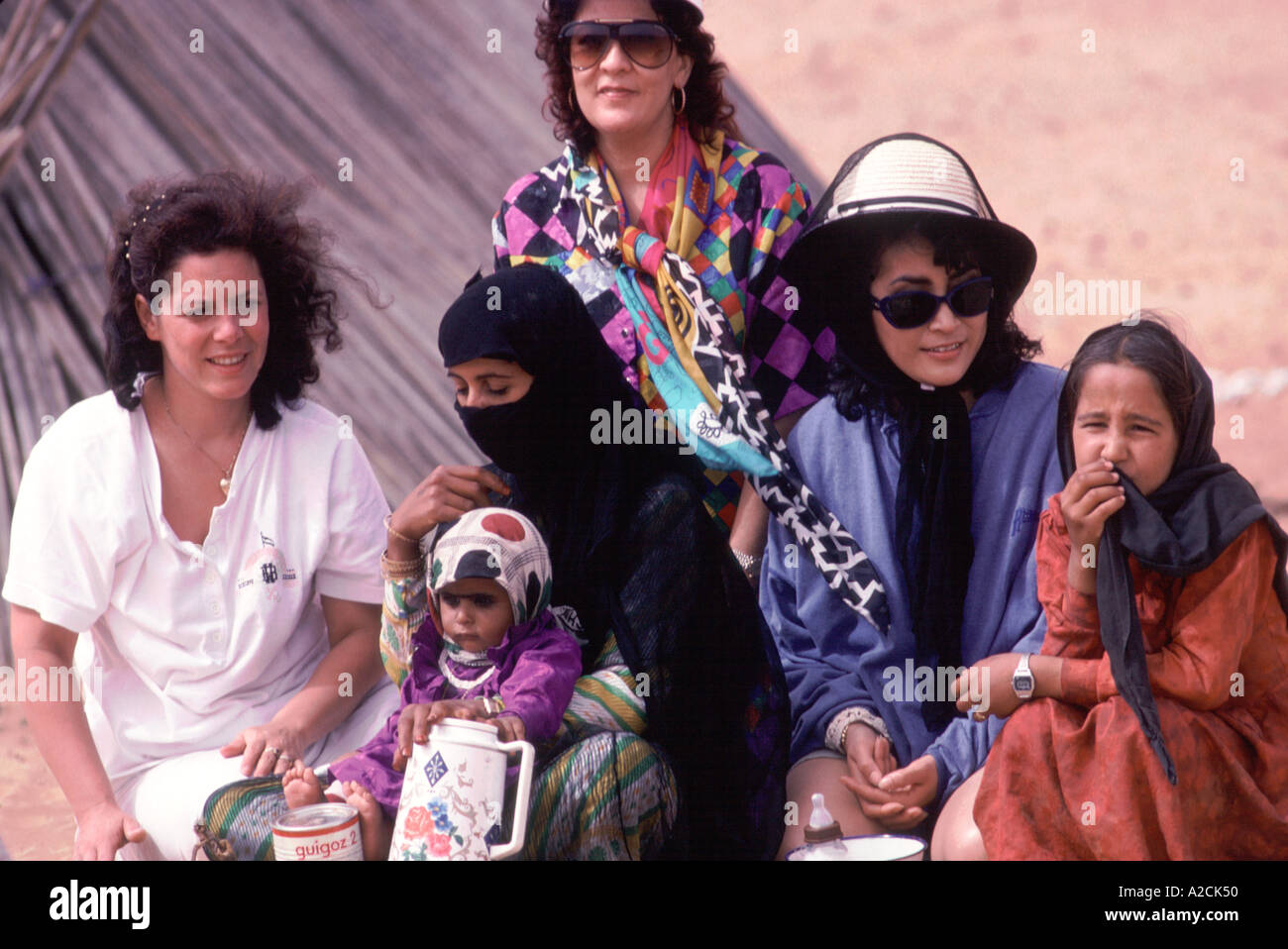 Oman. Wahiba Sands. Tourists visting Bedouin family. Bedus and city women got along just fine Stock Photo