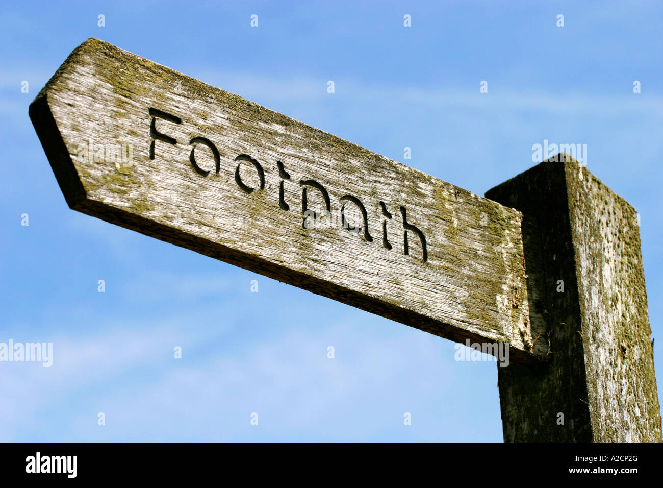 Wooden Footpath Sign showing the Line of the Public Footpath - Stock Image