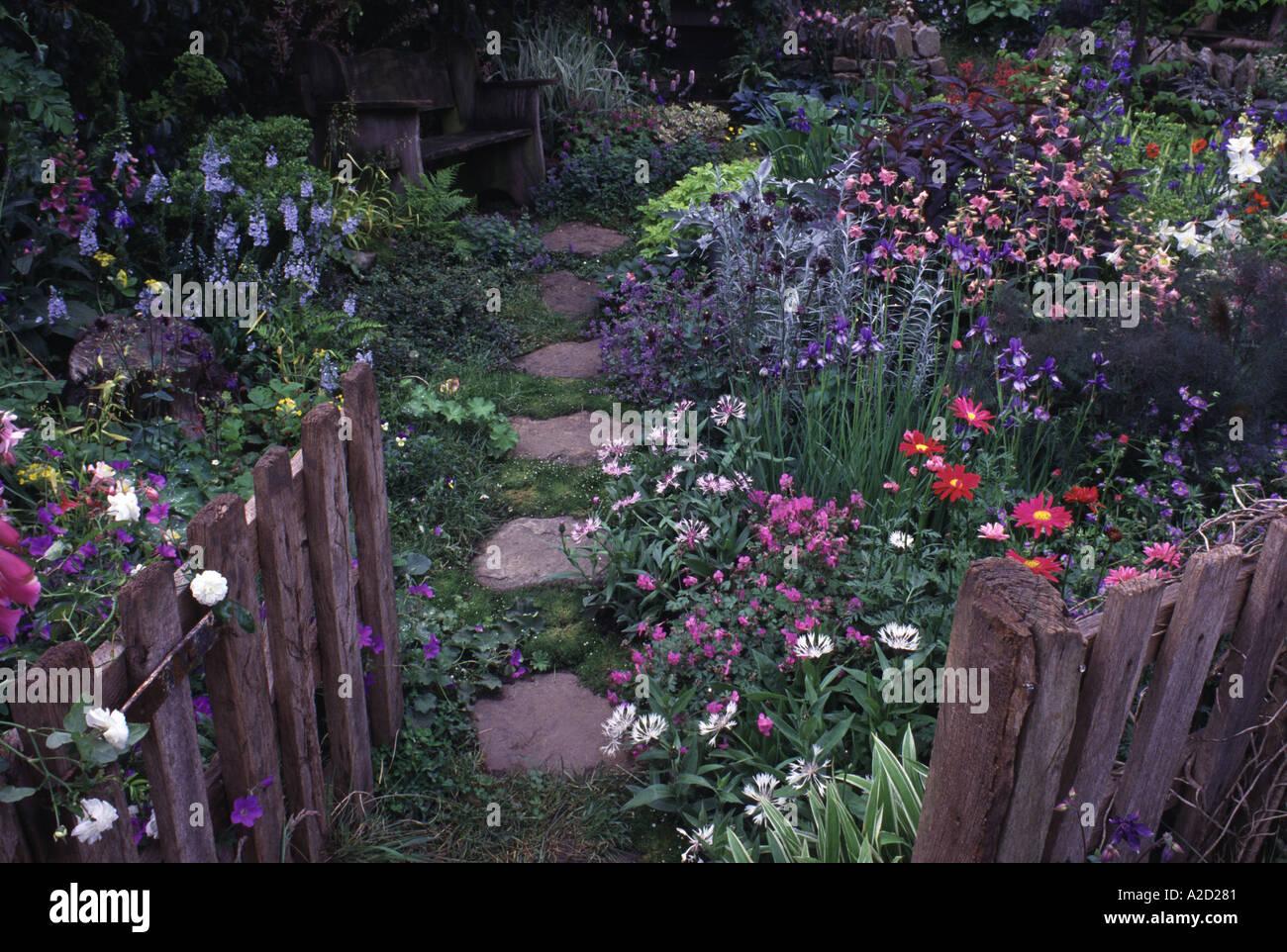 cottage planted garden looking through gate chelsea flower show 2002