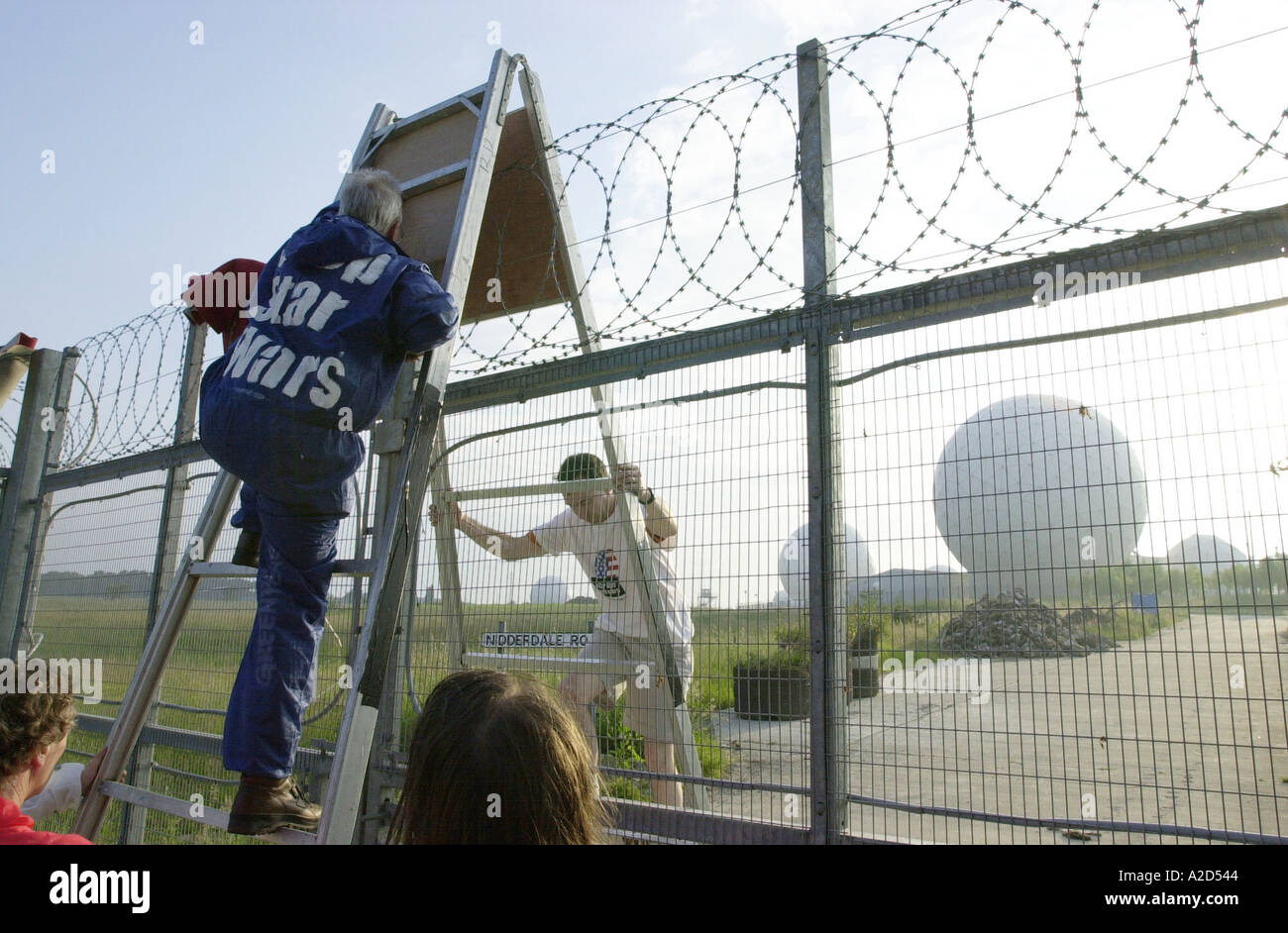 protesters climb into menwith hill early warning station in