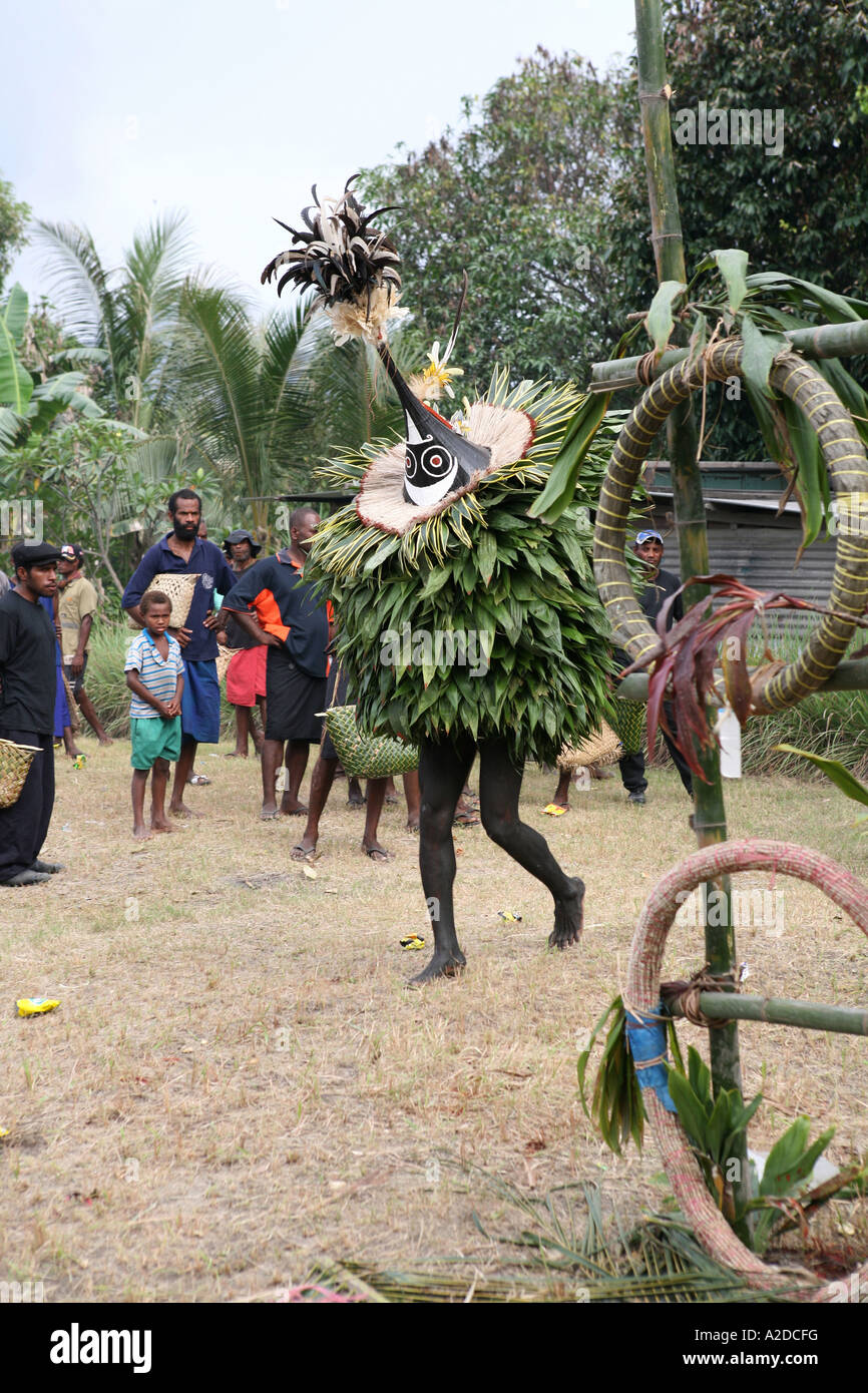 A Tubuan performs at a Tolai Death Ceremony, Matupit Island, East New Britain, Papua New Guinea - Stock Image