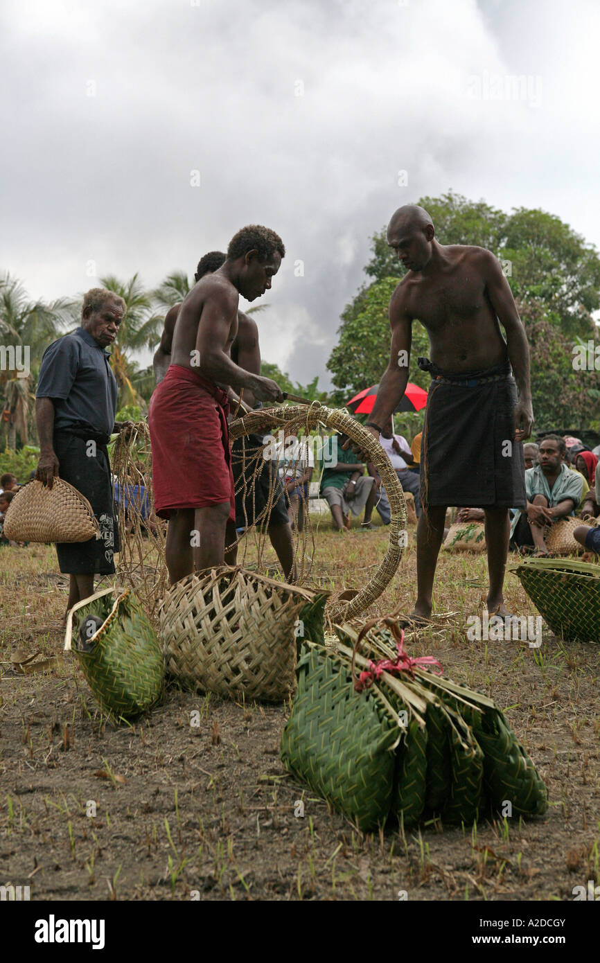 Tolai men distributing shell money for use in a Tolai Death Ceremony, Matupit Island, East New Britain, Papua - Stock Image