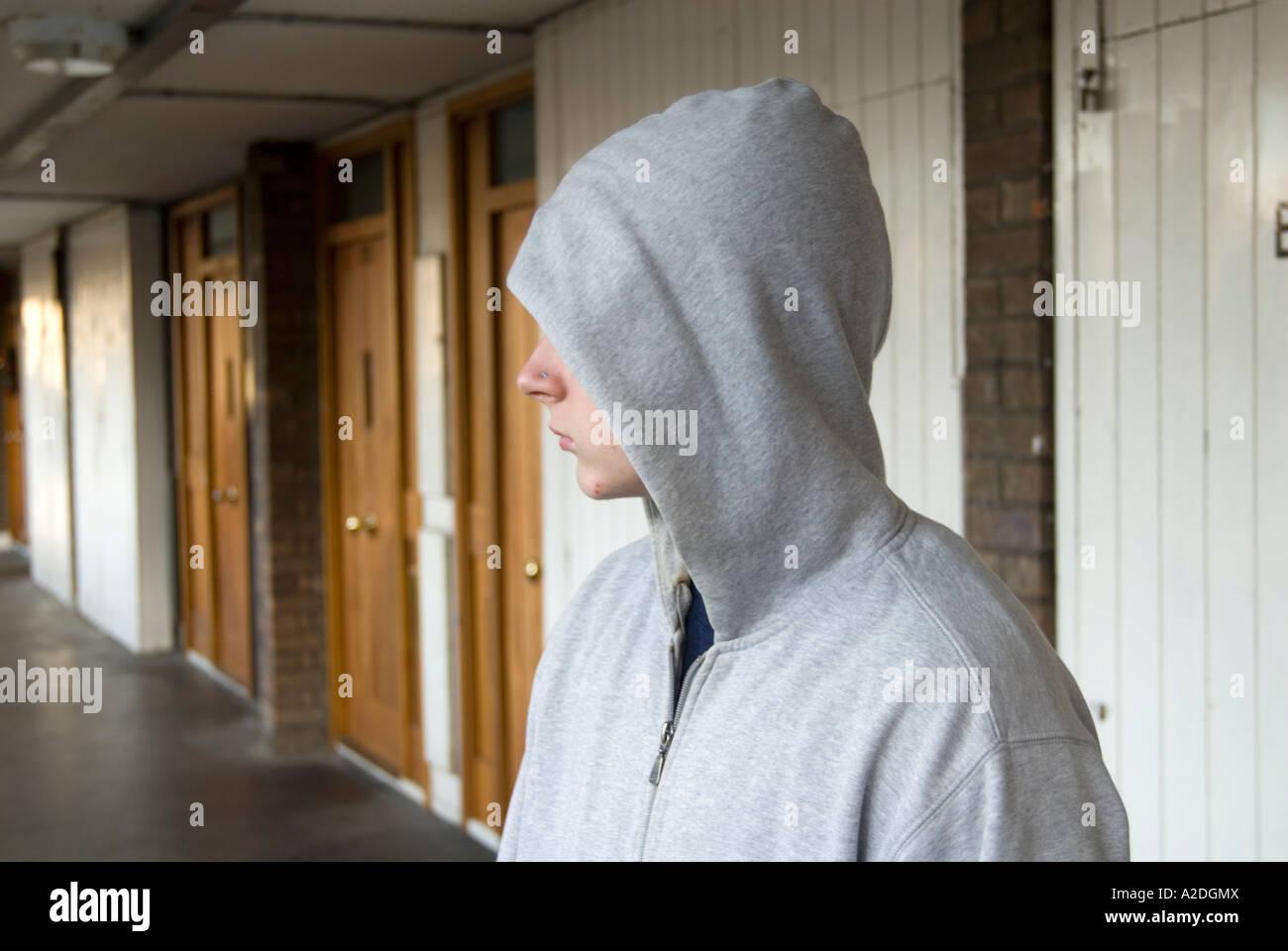 Teenager hanging around in hoodie clothing, London England UK - Stock Image