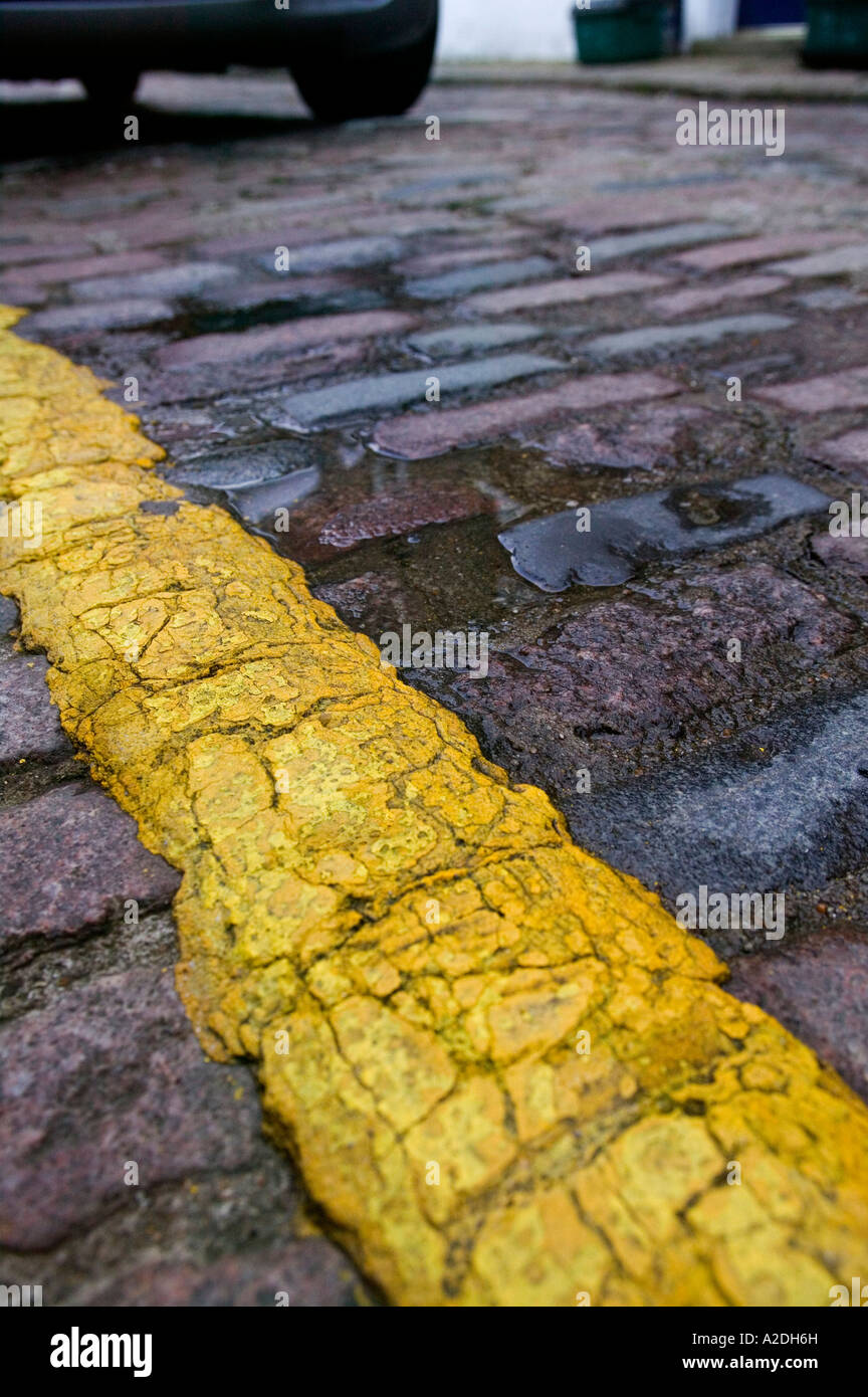 Yellow parking restriction line in London UK - Stock Image