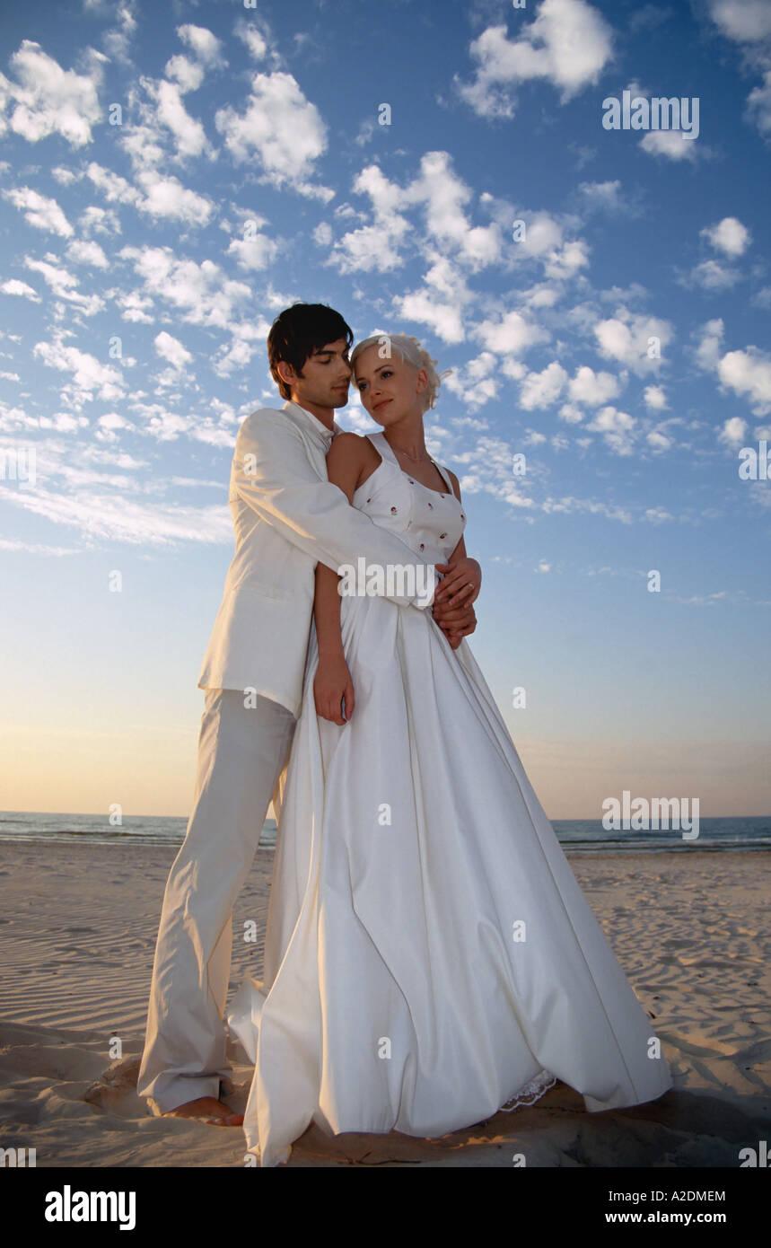 1207831 outdoor summer evening sunset beach sea water couple woman ...