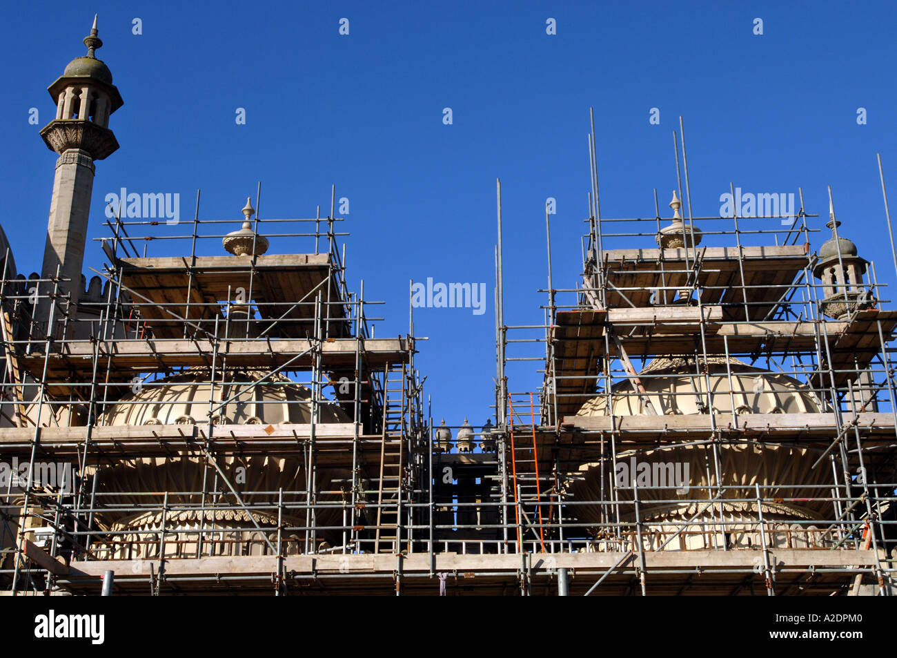 The domes of the Prince Regents Palace The Royal Pavilion Brighton East Sussex are covered in scaffolding for stonework repairs - Stock Image