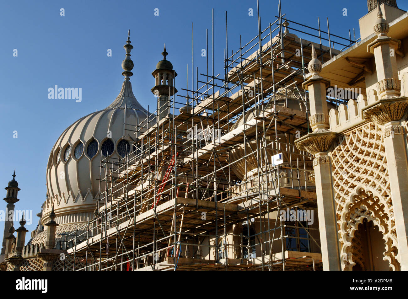 The domes of the Prince Regents Palace The Royal Pavilion Brighton East Sussex are covered in scaffolding for stonework Stock Photo