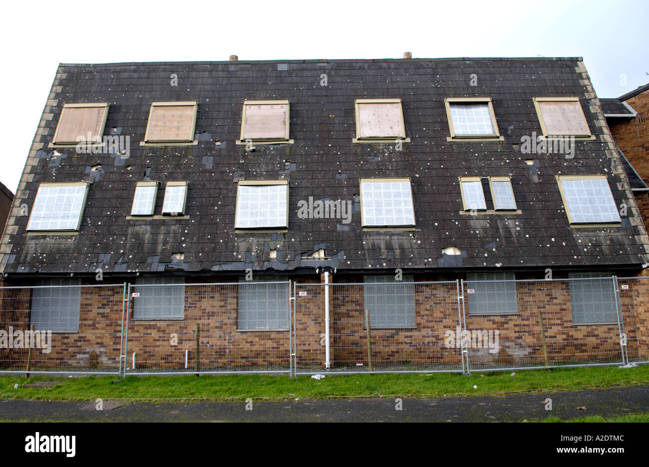 Houses derelict and boarded up in Llanelli Carmarthenshire West Wales UK - Stock Image