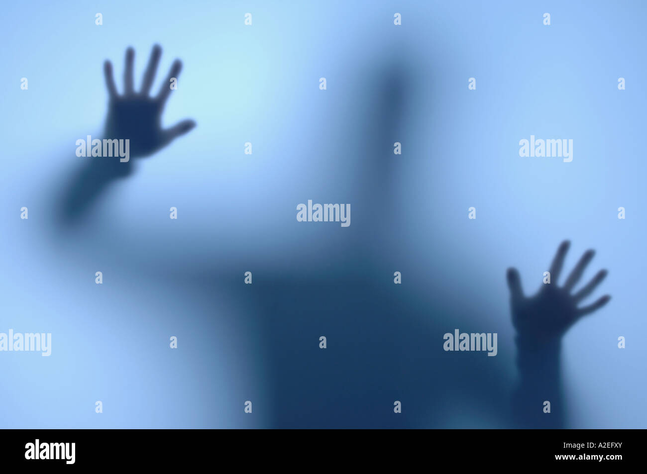 Person behind a frosted window - Stock Image