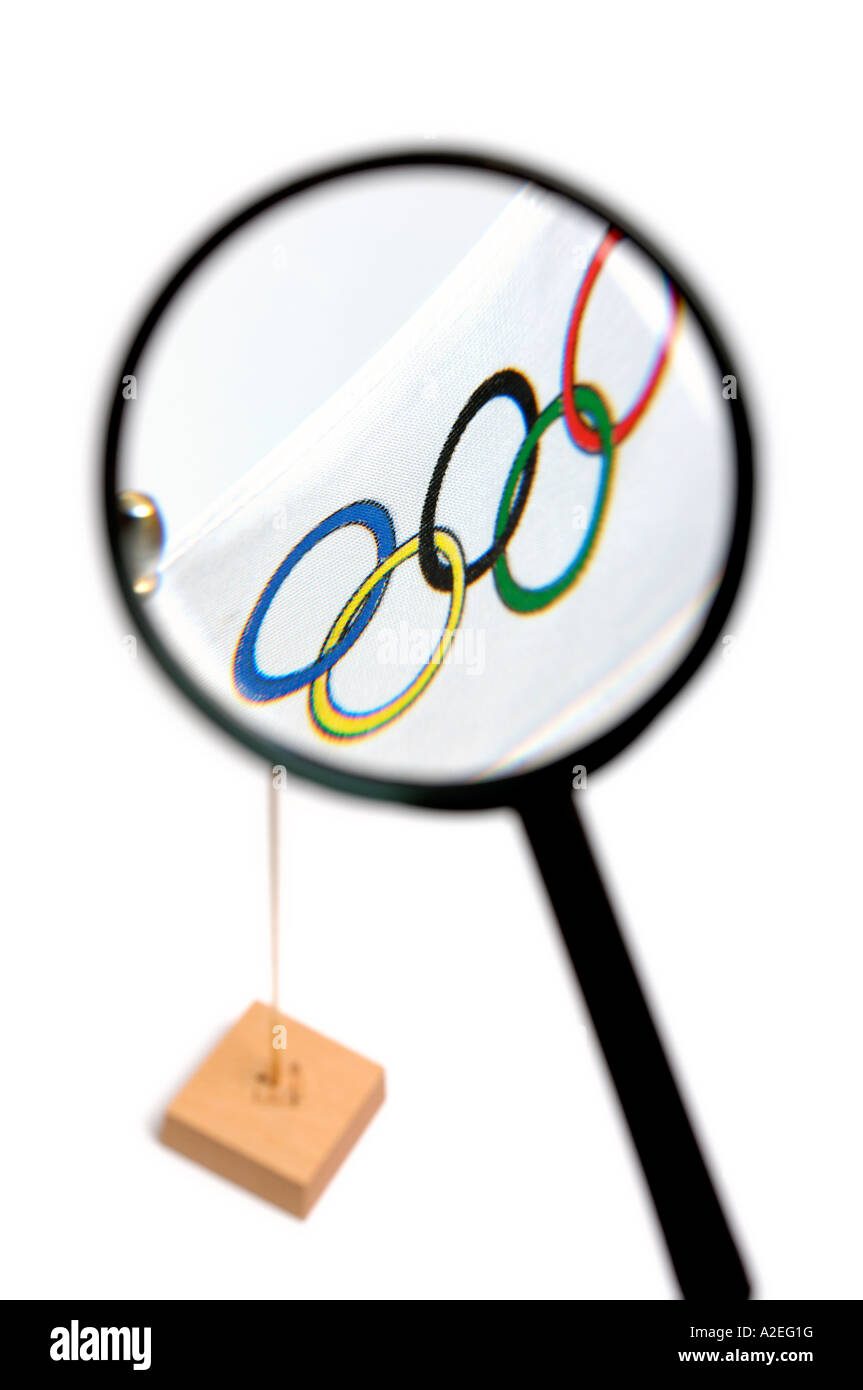 Magnifying glass and Olympic flag - Stock Image