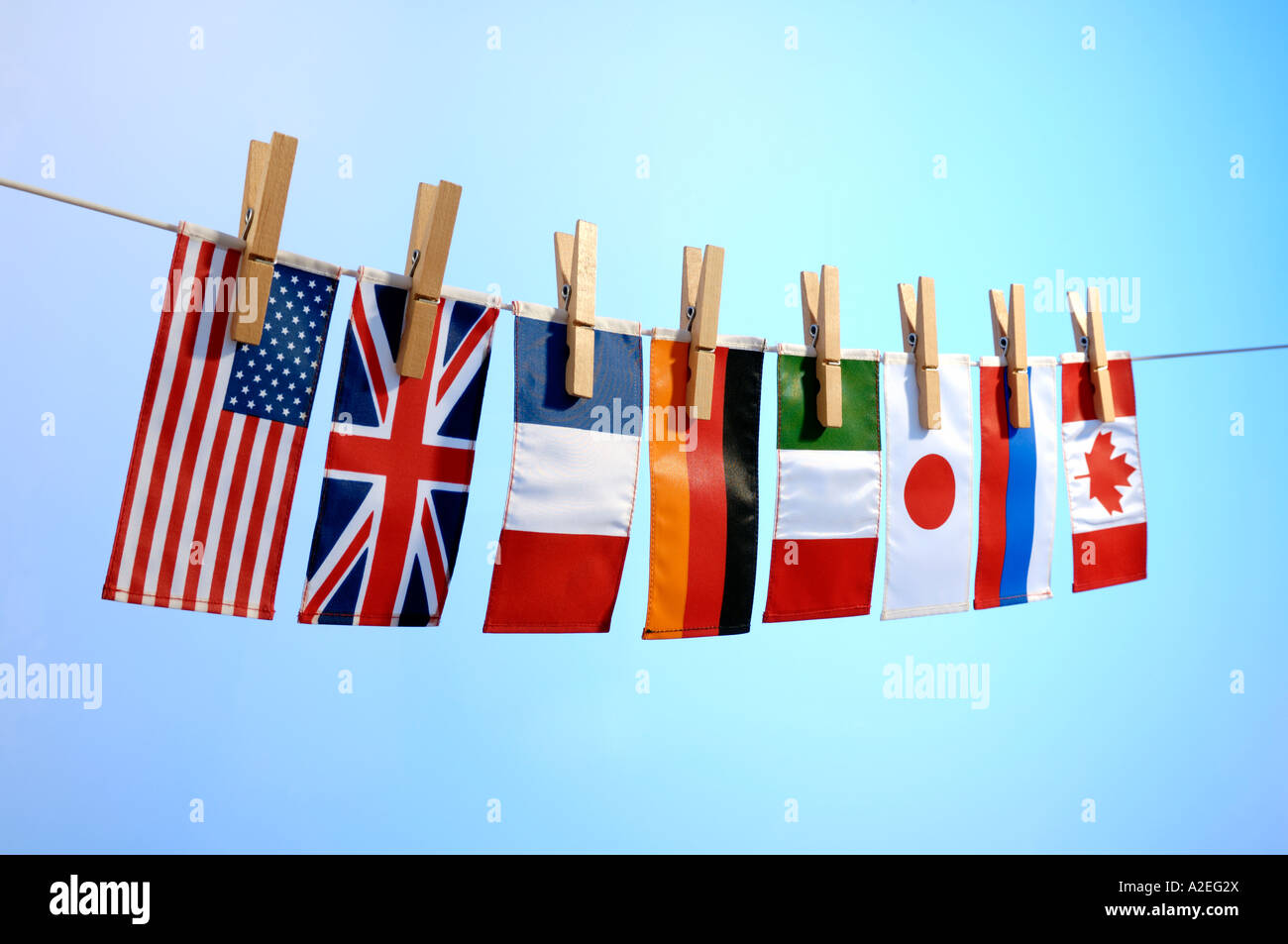 Flags of the G8 nations pegged on a washing line - Stock Image