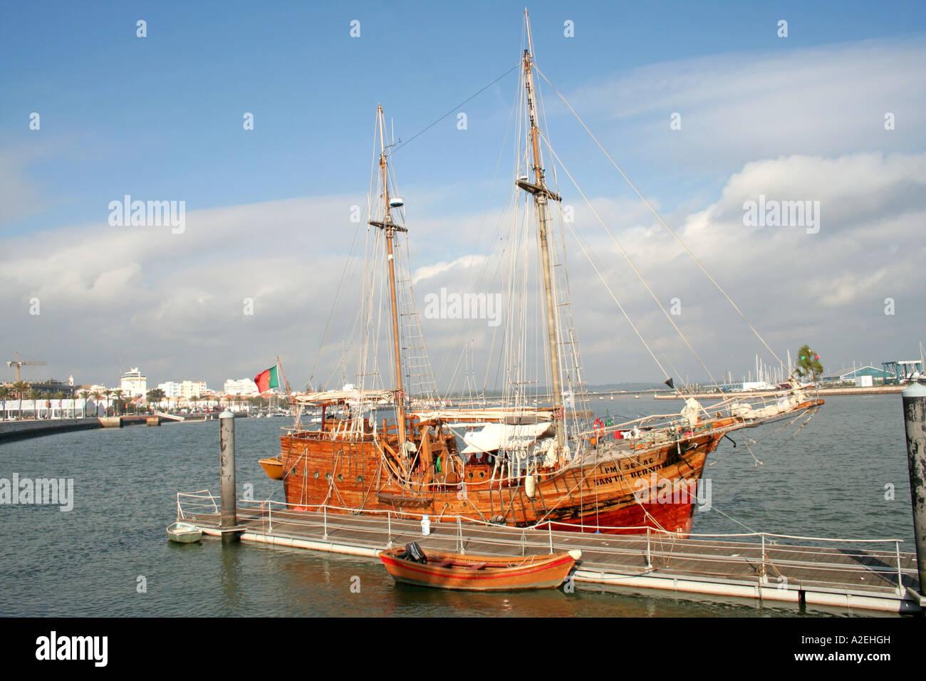 Replica of old historic Sailing Boat Santa Bernarda Caravelo at Portimao Harbour Algarve Portugal - Stock Image