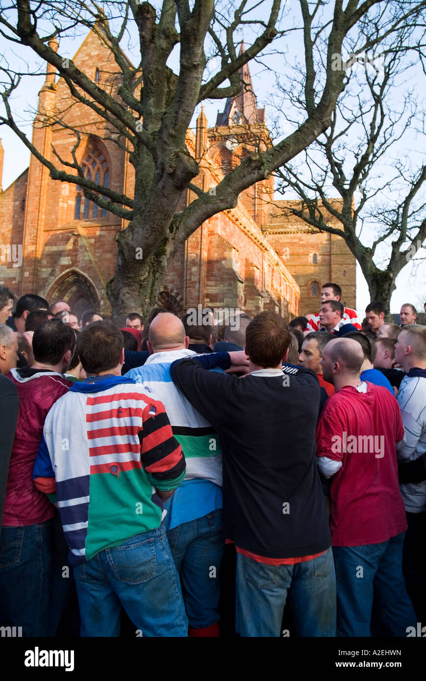 dh The Ba KIRKWALL ORKNEY Pack of Ba players St Magnus Cathedral christmas day ball game Scotland Stock Photo