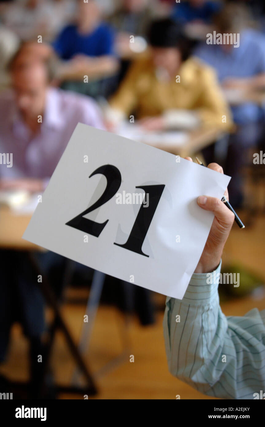 A CONTESTANT DISPLAYS HIS NUMBER AFTER FINISHING AT THE TIMES NATIONAL CROSSWORD COMPETITION CUP DURING THE CHAMPIONSHIPS Stock Photo