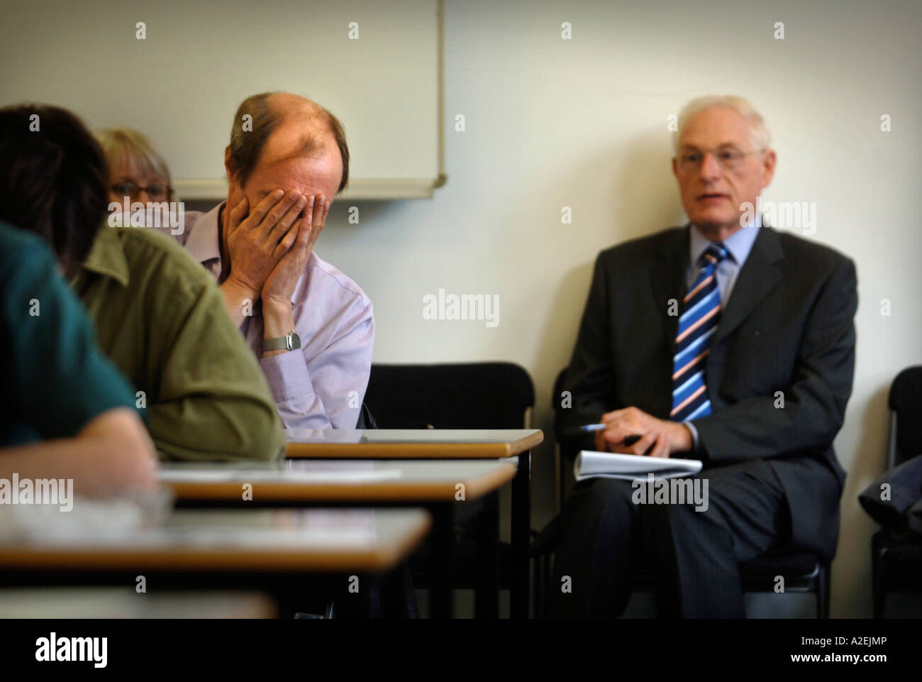 A CONTESTANT REALISES HE HAS MADE AN ERROR AT THE TIMES NATIONAL CROSSWORD COMPETITION CUP FINAL DURING THE CHAMPIONSHIPS Stock Photo