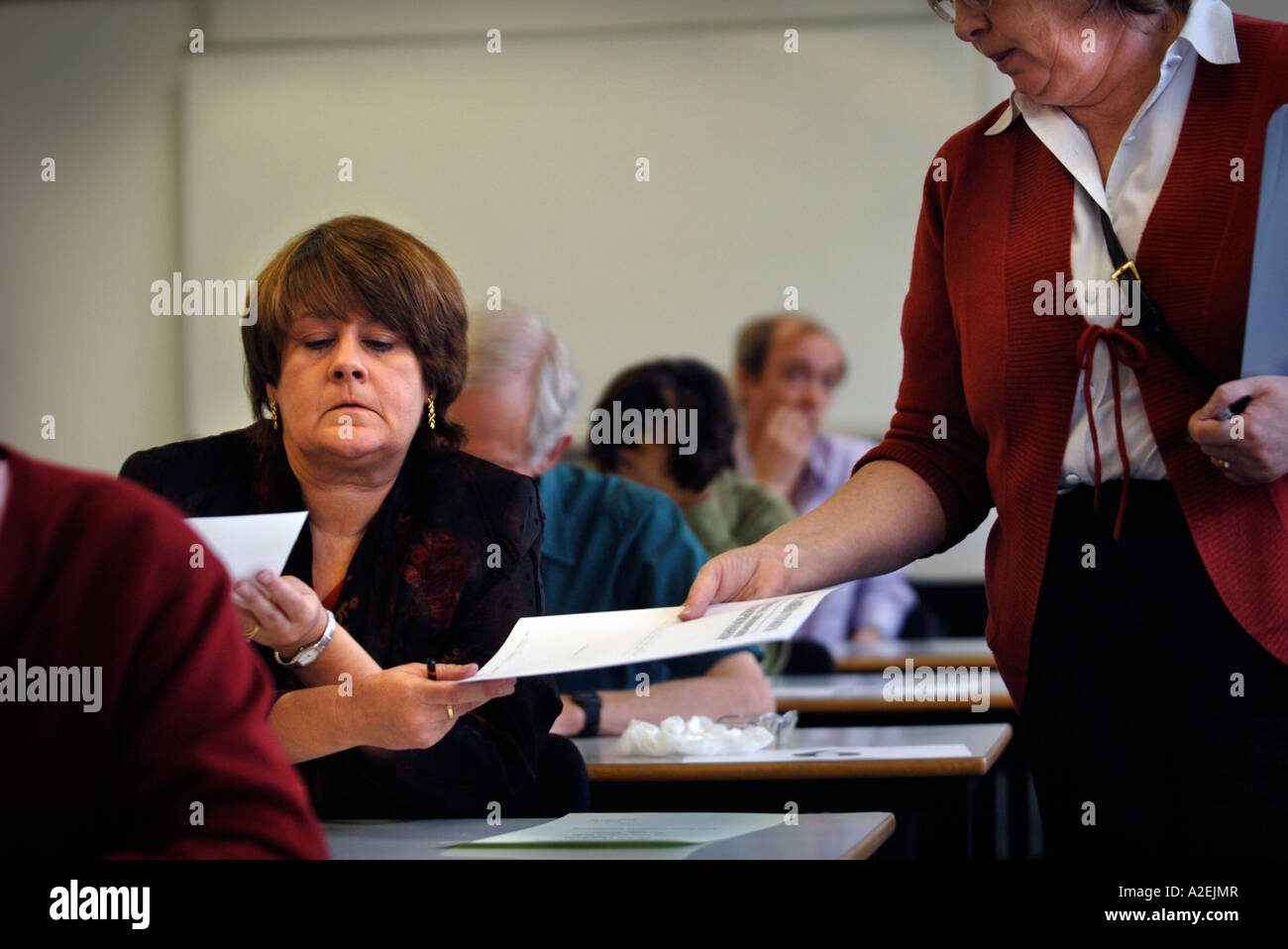 HELEN OUGHAM HANDS IN HER WINNING ENTRY AT THE TIMES NATIONAL CROSSWORD COMPETITION CUP FINAL DURING THE CHAMPIONSHIPS Stock Photo
