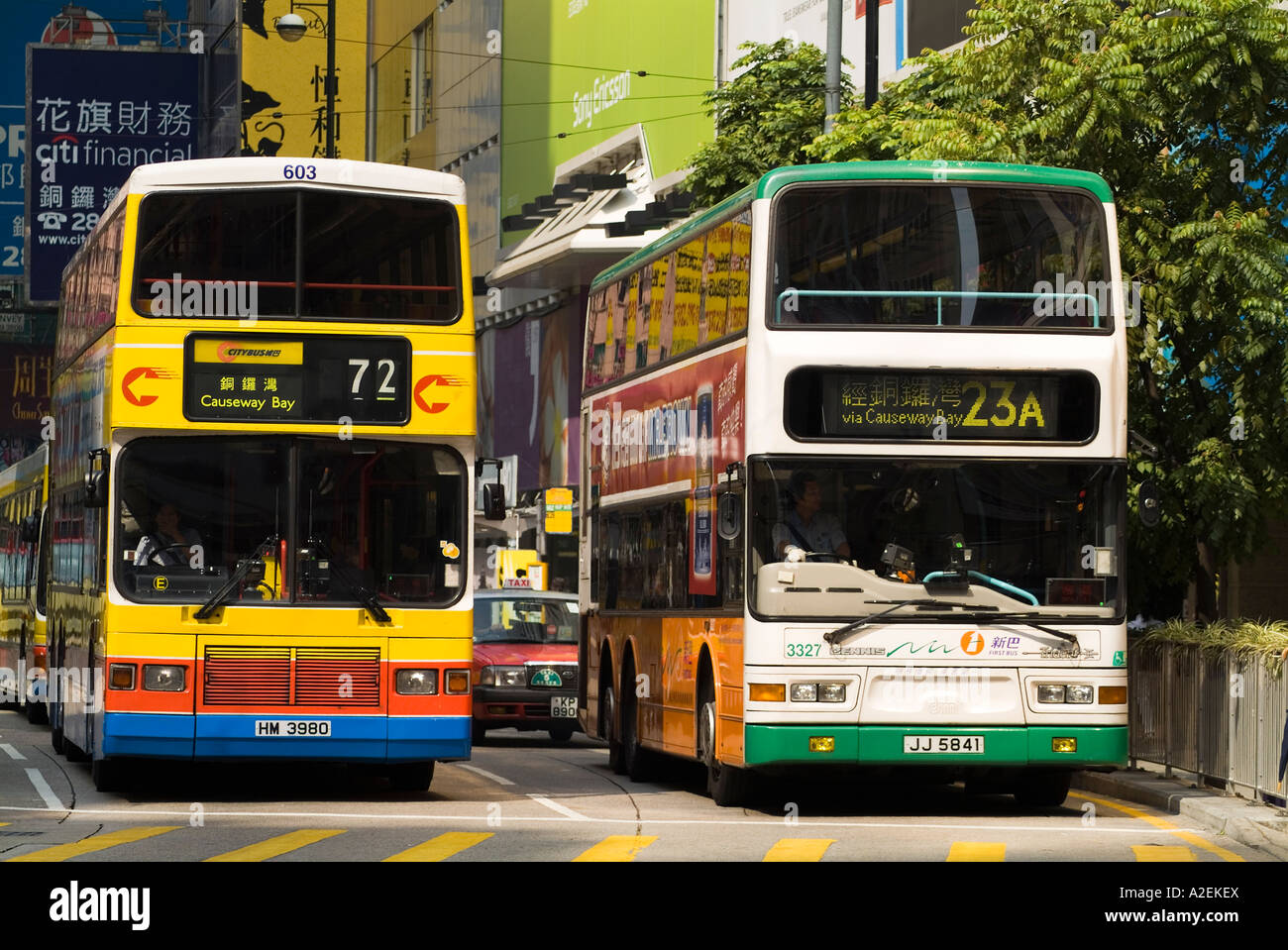 dh Yee Wo street CAUSEWAY BAY HONG KONG Two rival bus companies First Bus and Citybus double decker buses transport Stock Photo