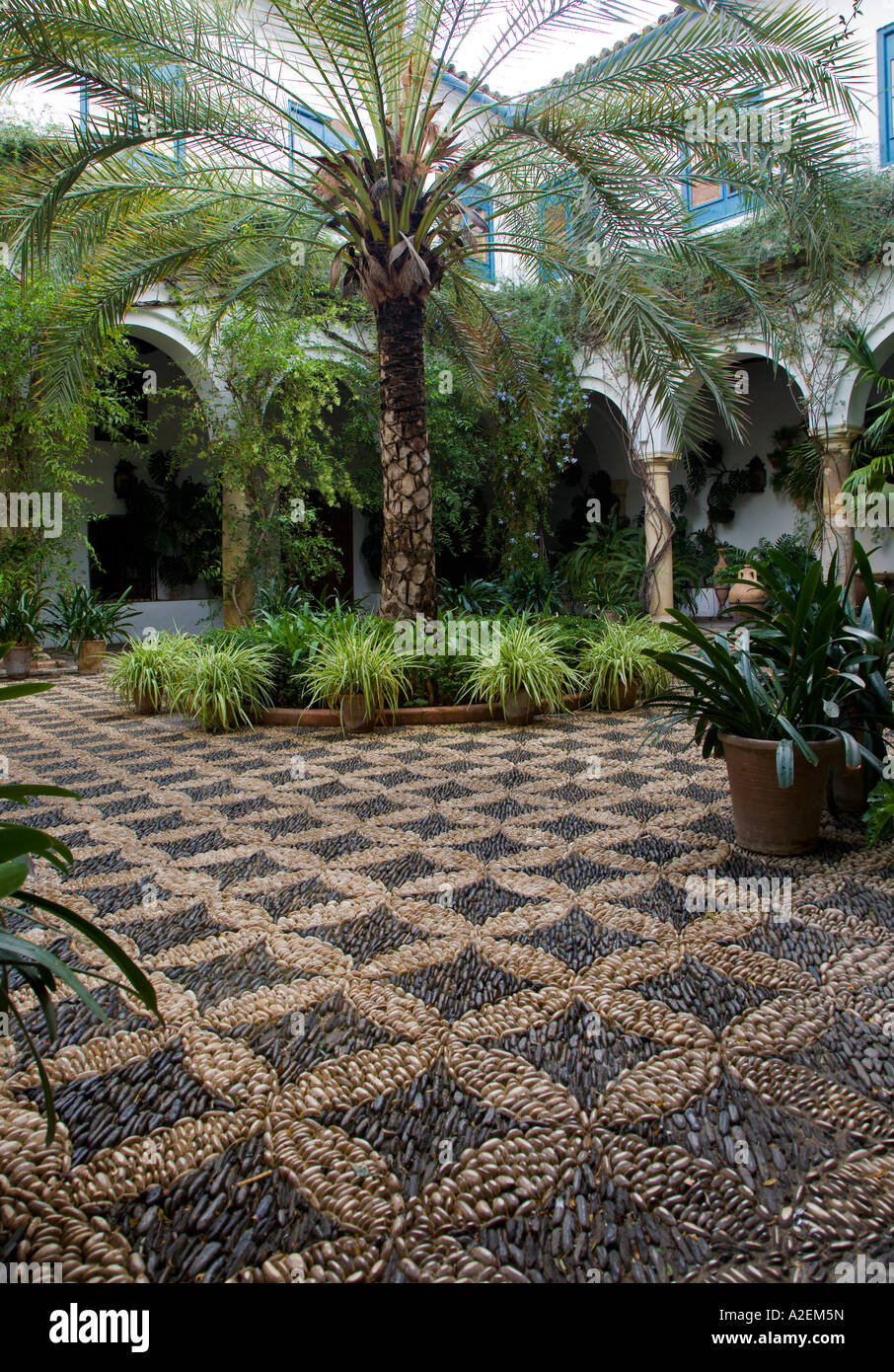 Pebble mosaic courtyard in the 15th Century Viana Palace Cordoba Andalucia, Spain. 2006 - Stock Image