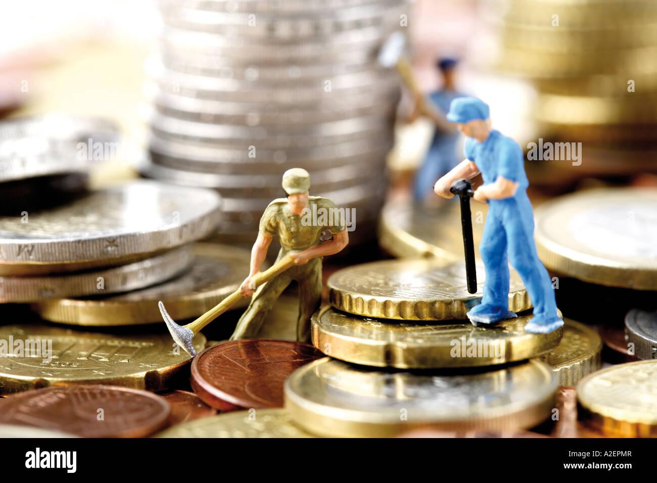 Figurines digging money, close-up Stock Photo