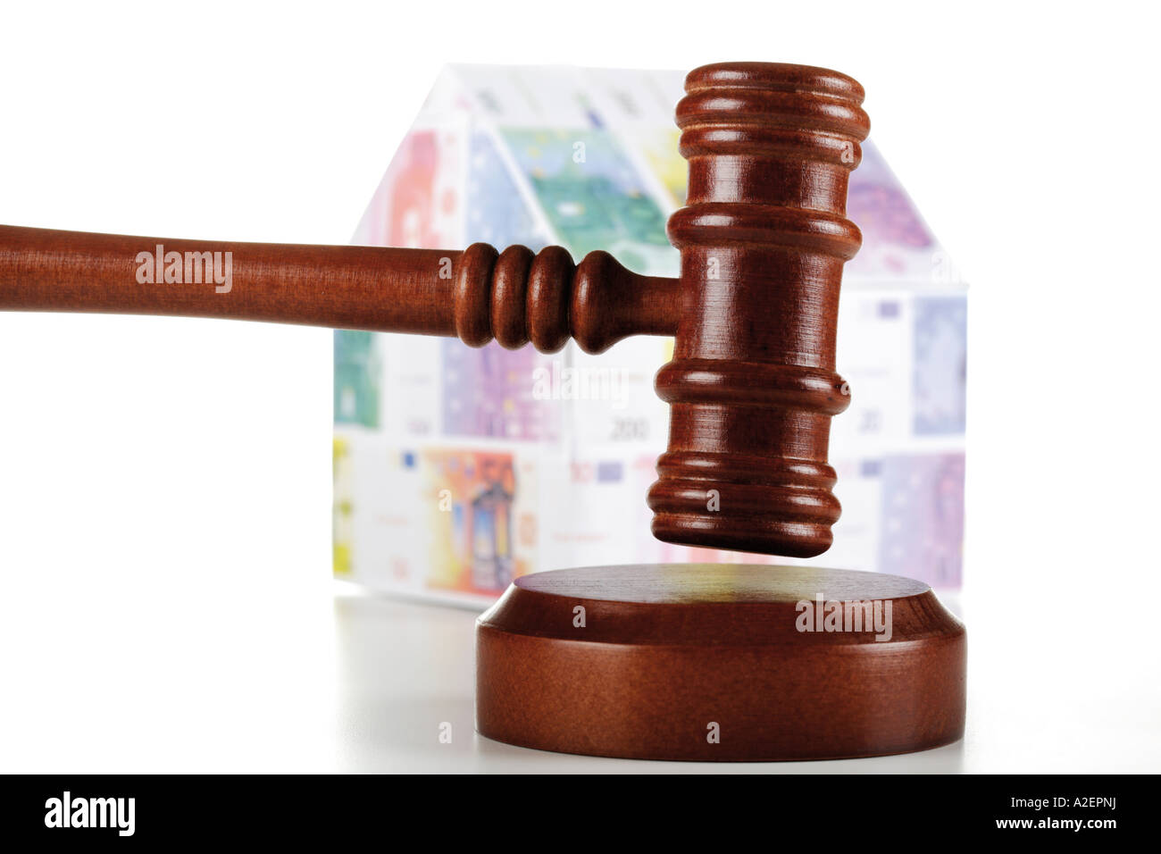 Auctioneer's hammer and house of Euro notes, close-up Stock Photo