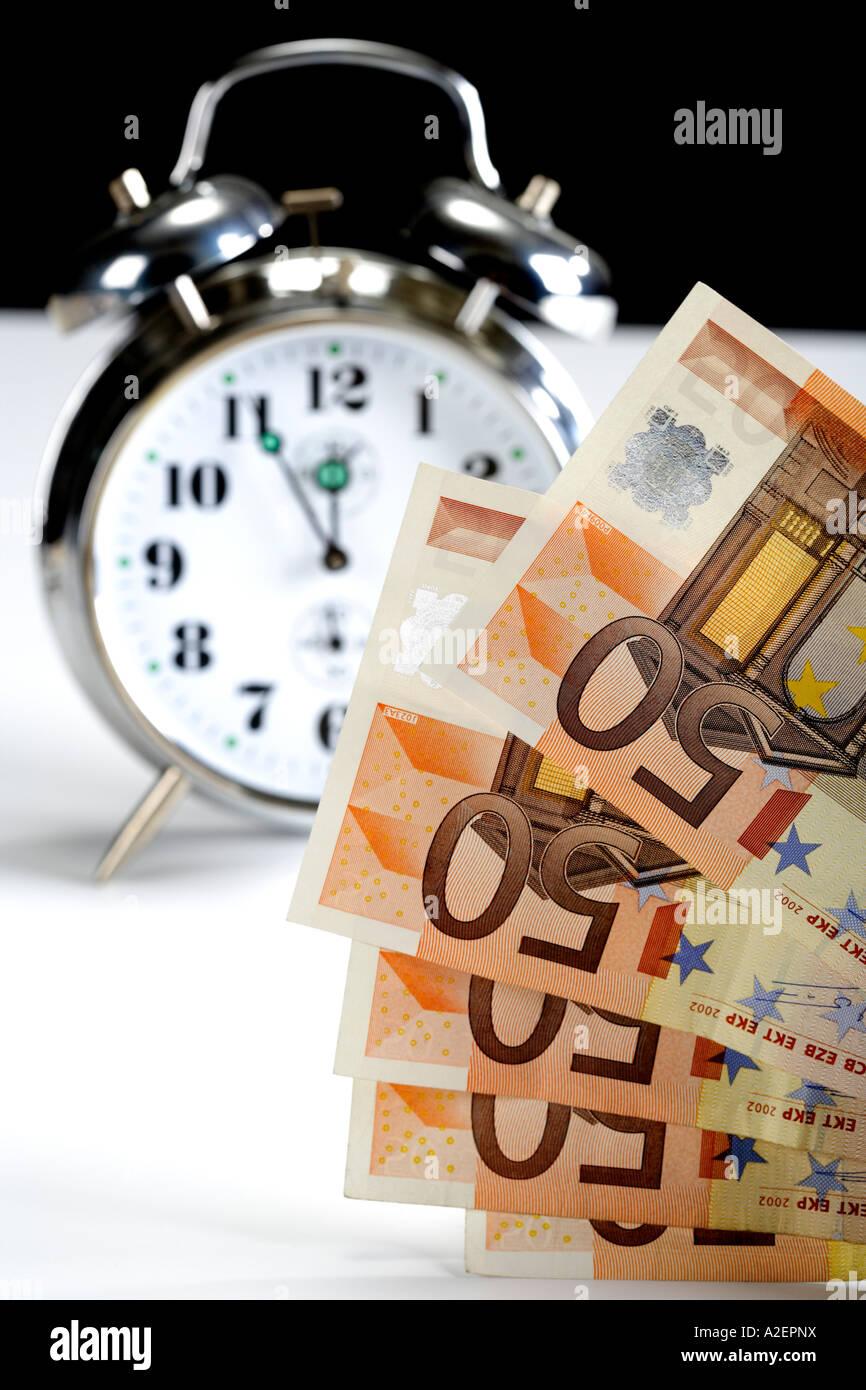 Alarm clock and Euro notes Stock Photo