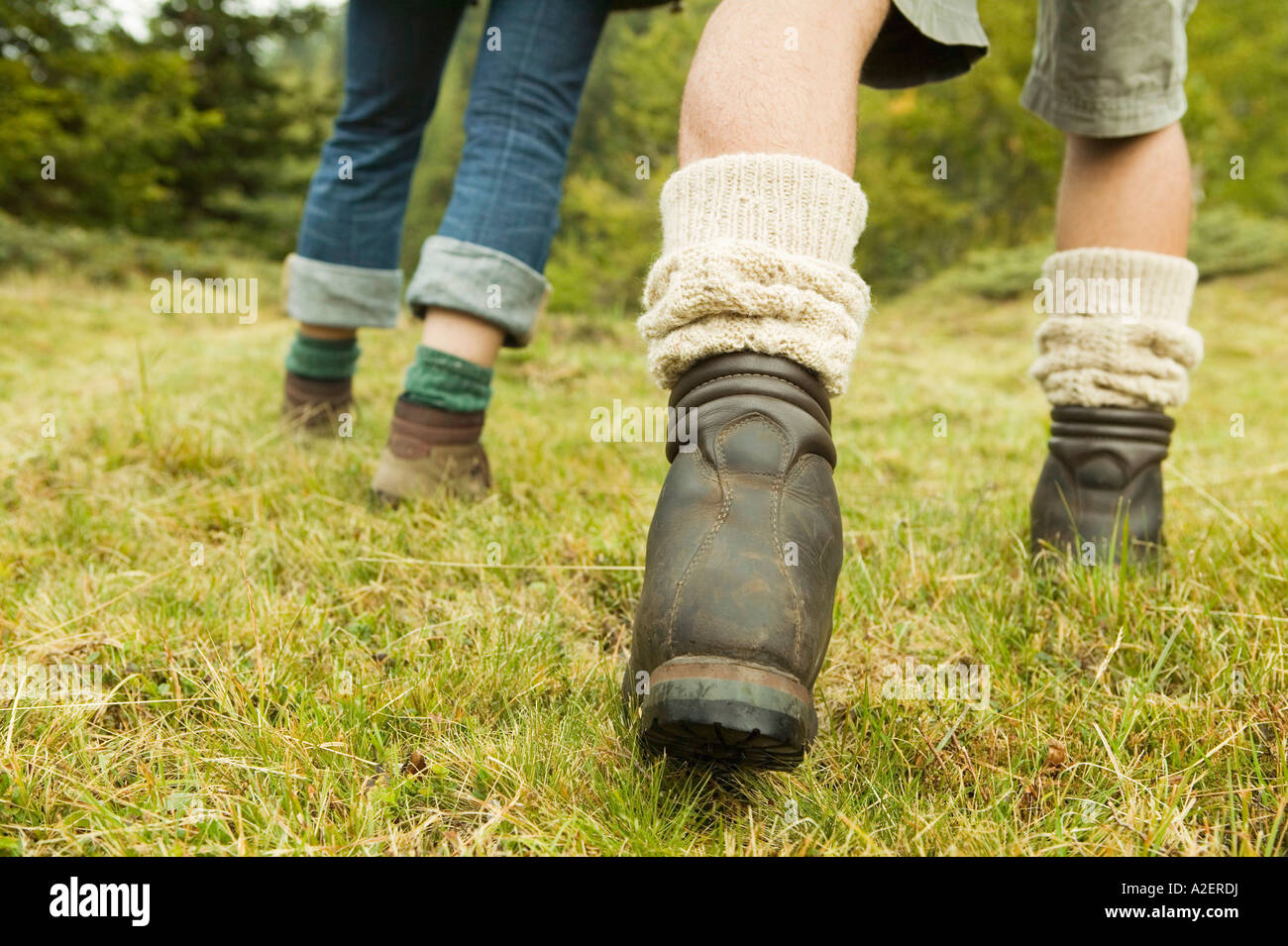 Two persons walking in meadow, detail - Stock Image