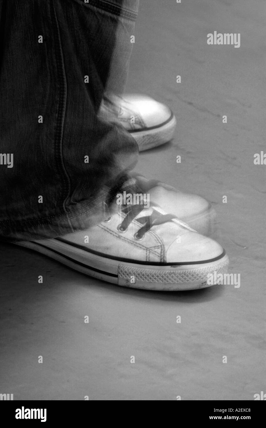 Toe tapping tap beat rhythm sneaker trainer training shoe music musician play - Stock Image