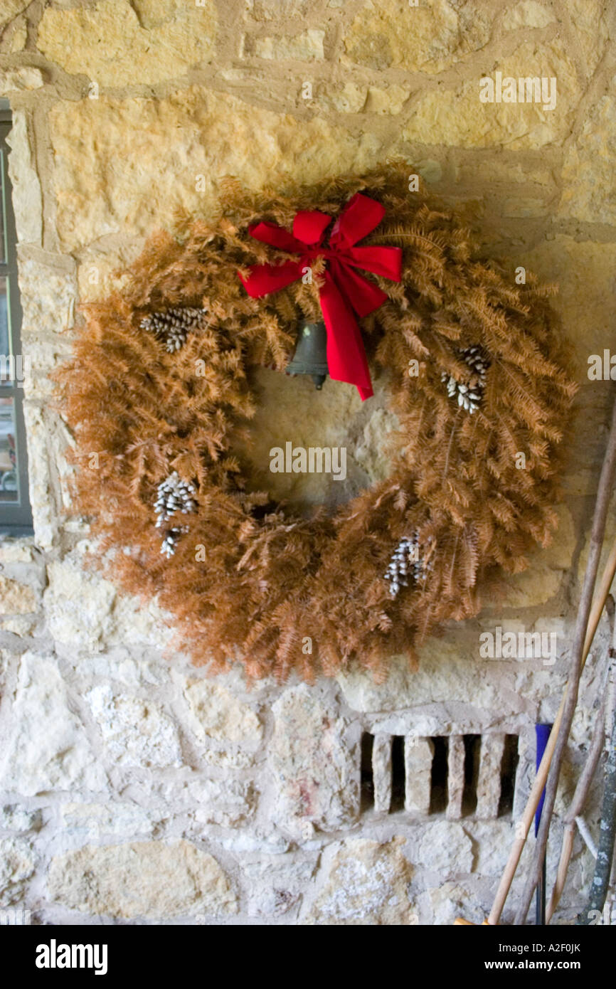Beautiful dried up Christmas wreath forgotten on hunting lodge wall. Concept - Retired. Blue River Wisconsin USA Stock Photo