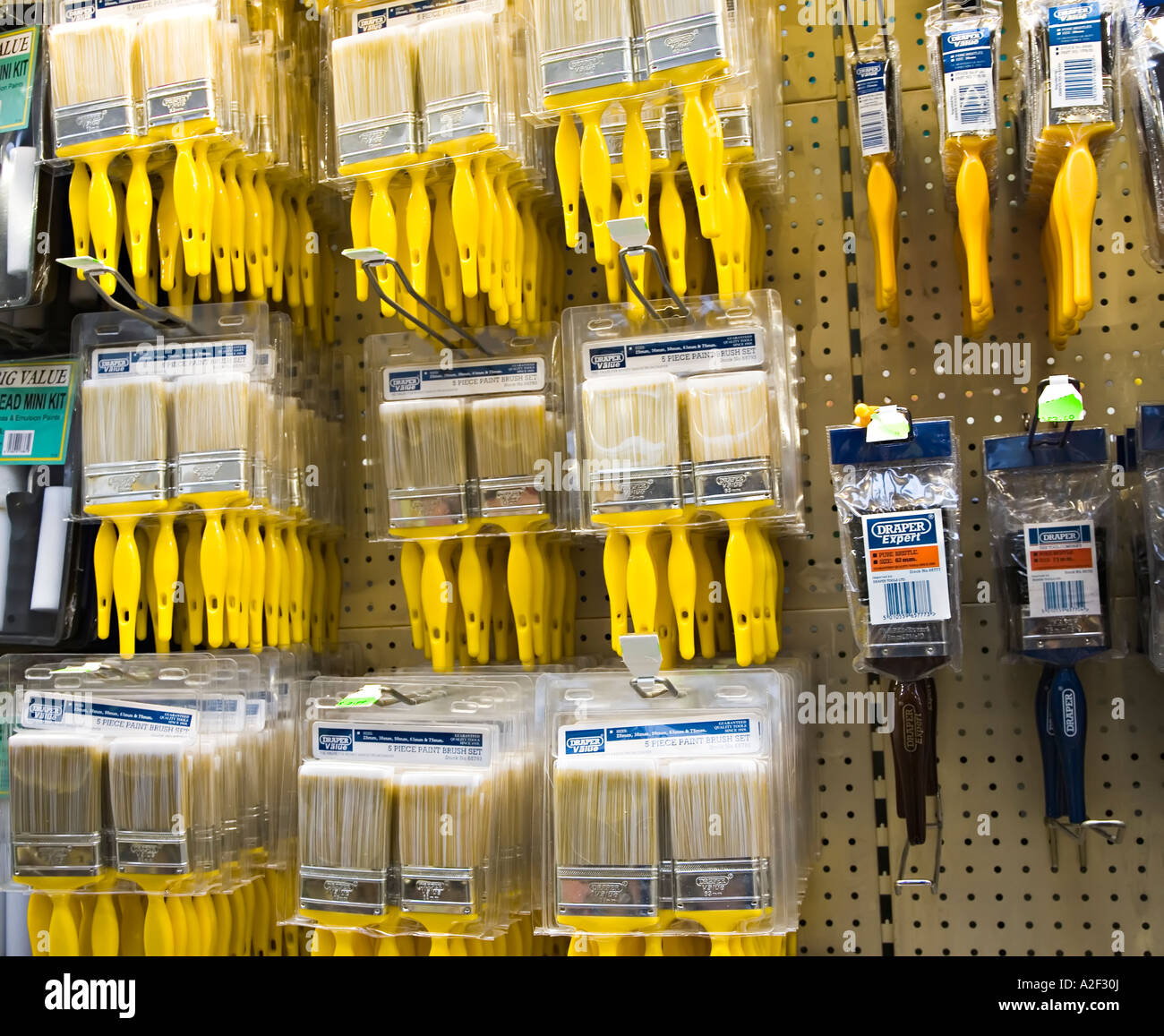 Paintbrushes on sale in DIY store Wales UK - Stock Image