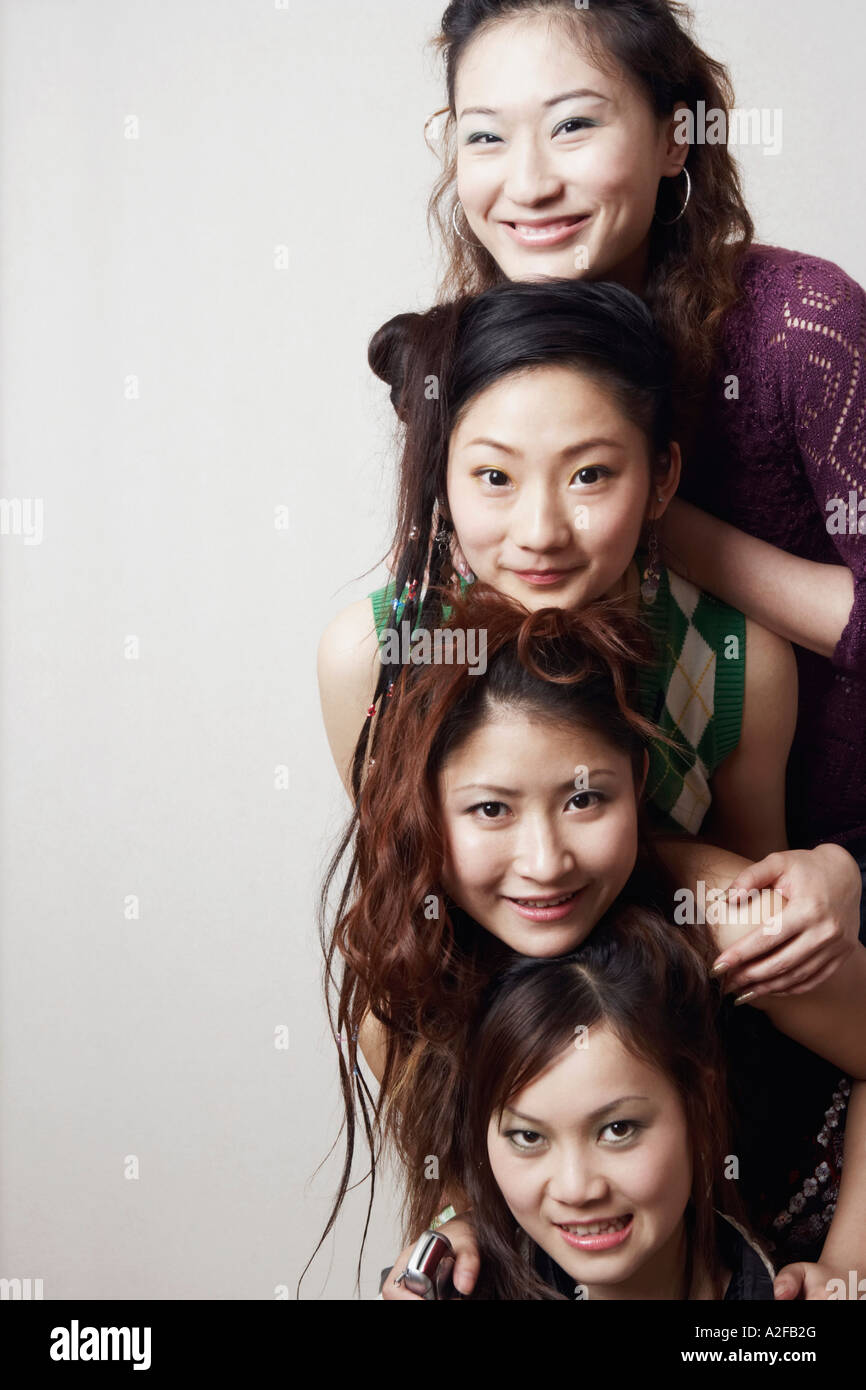 Portrait of three young women and a teenage girl - Stock Image