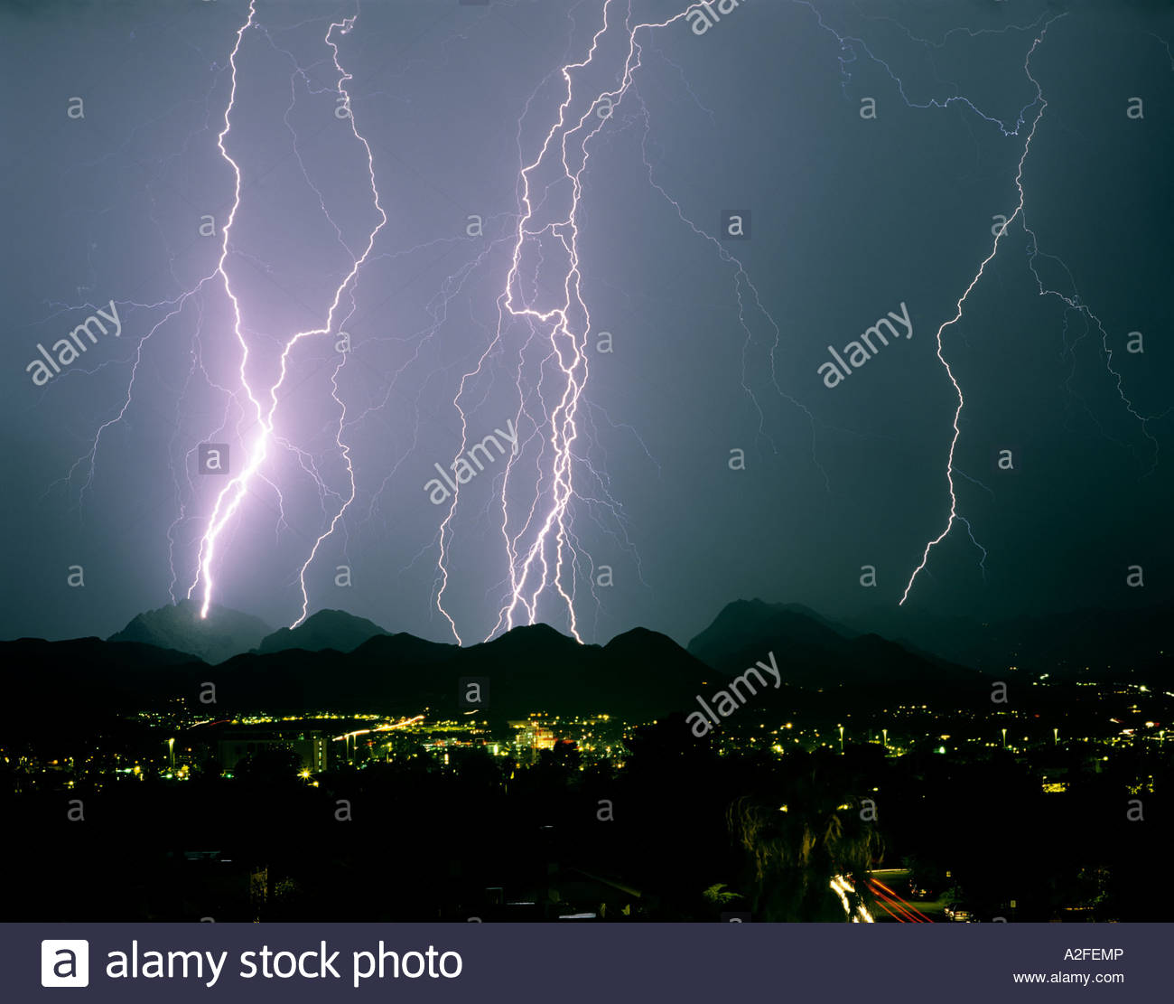 Tucson Mountains During Monsoon Thunderstorm With Lighting Bolts.