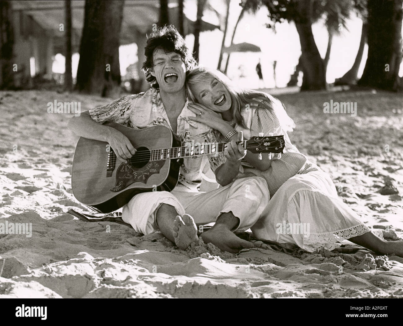 Mick Jagger and Jerry Hall in Barbados in December 1983 She is  pregnant with Elizabeth their first child - Stock Image