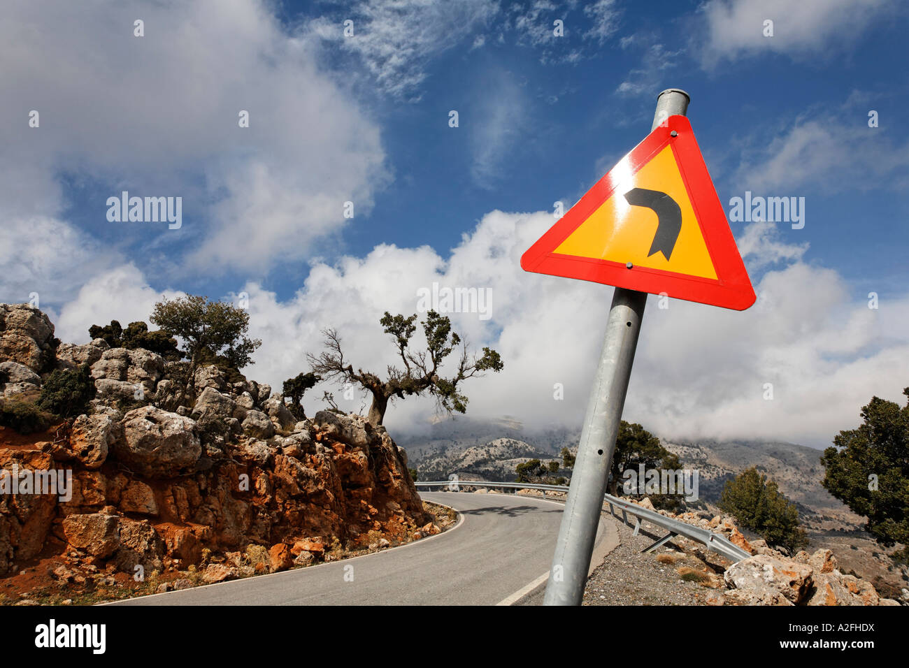 Road Sign Curves ahead, mountain road, Kritsa, Crete, Greece - Stock Image