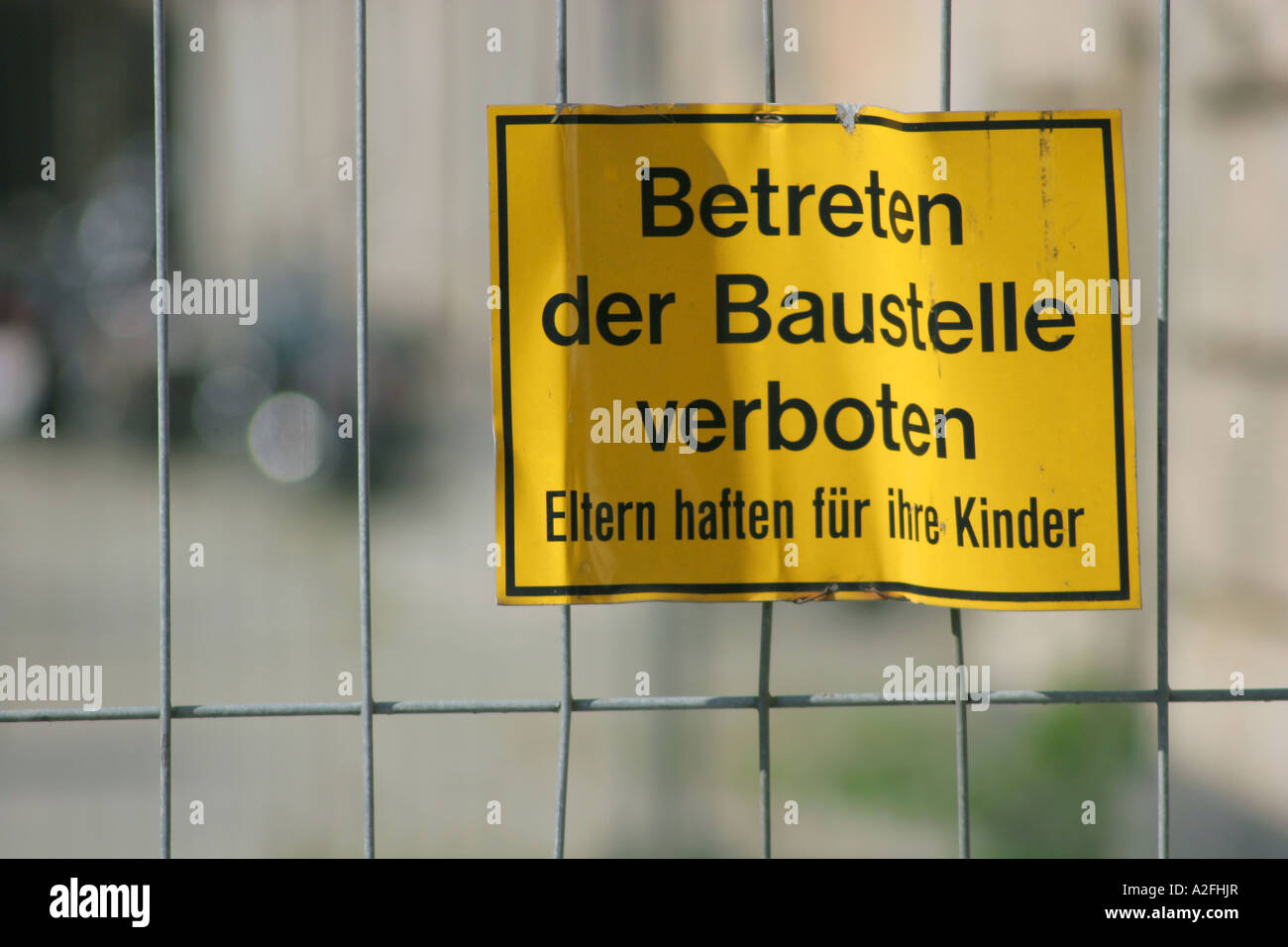 Warning label at a building site - parents are liable for their children Stock Photo
