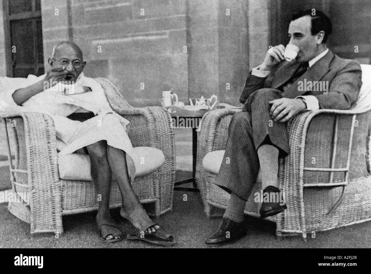 Mahatma Gandhi eating and Lord Mountbatten sipping tea Delhi India - 1947 - Stock Image