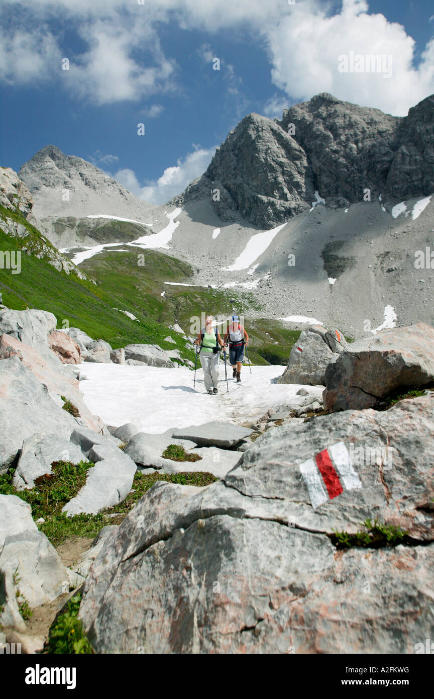 Two people hiking in austrian alps - Stock Image