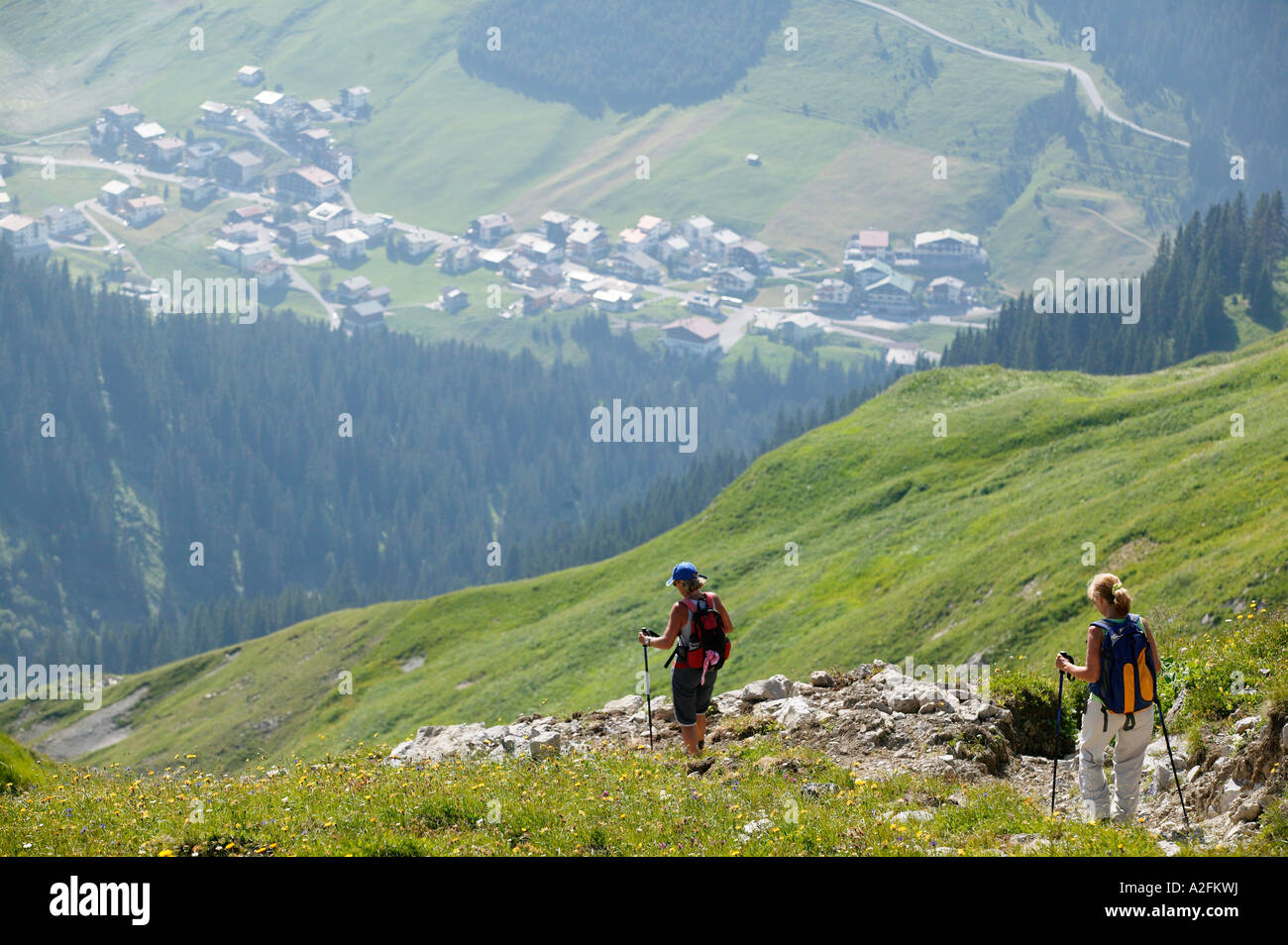 Two people hiking in mountains - Stock Image