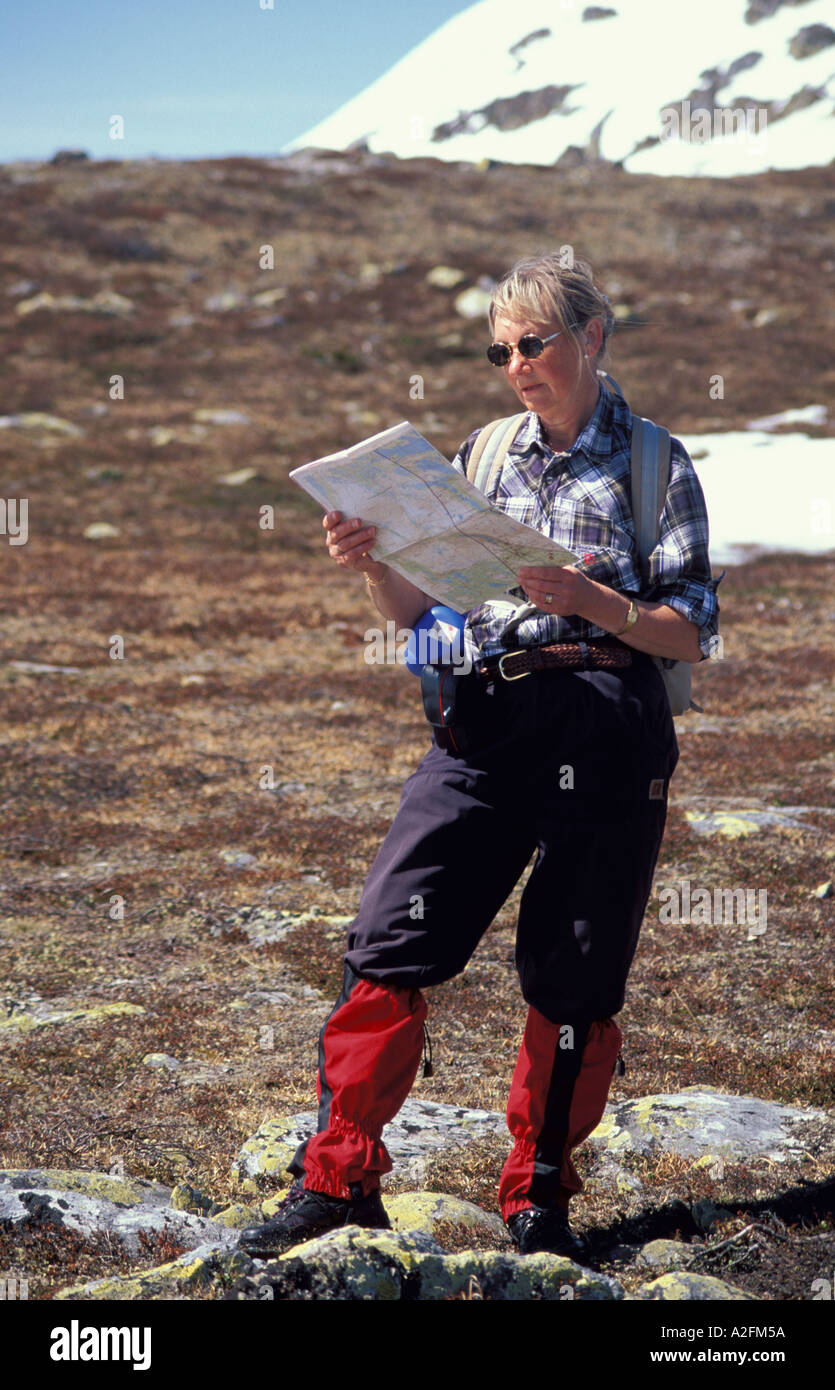 Cross Country Walker looking at map Norway - Stock Image
