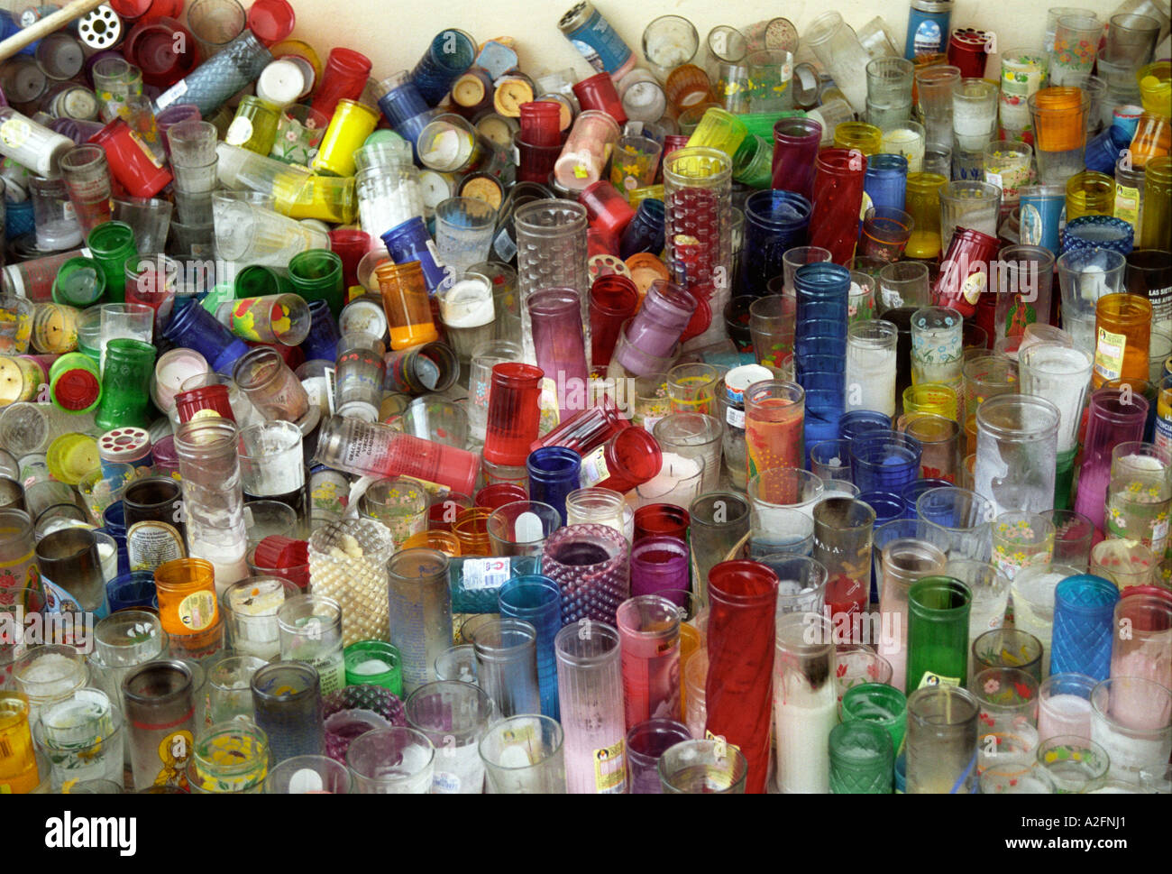 A thousand colourful colorful plastic candle holders - Stock Image