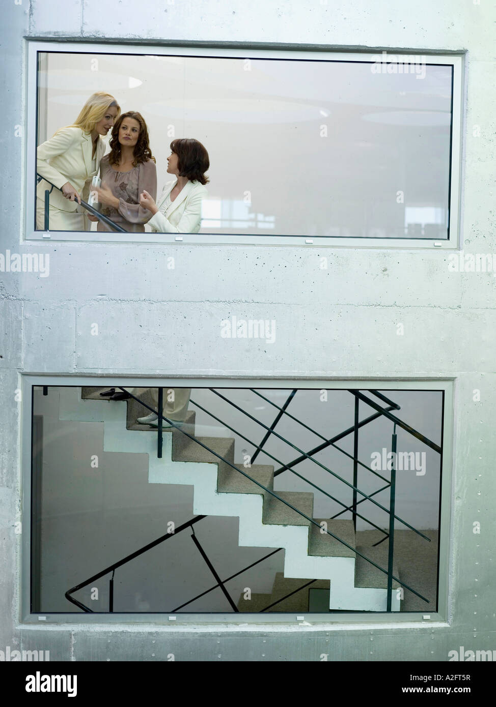 Woman on staircase - Stock Image