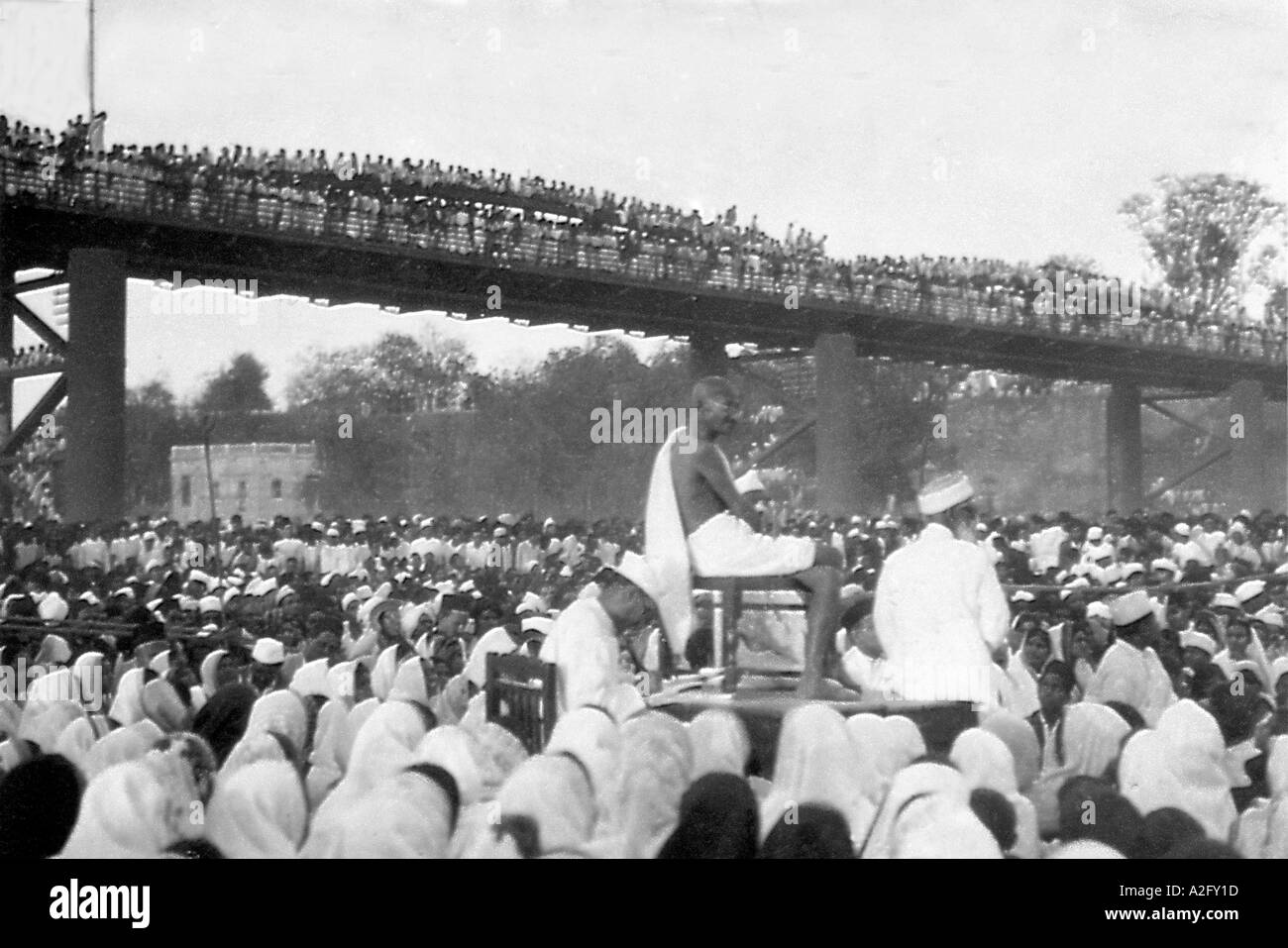 Mahatma Gandhi delivering a speech to the crowd in the dry river bed of Sabarmati river Ahmedabad Gujrat India - Stock Image