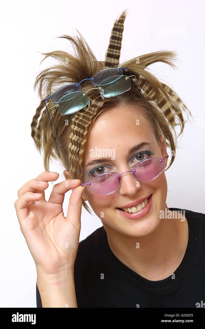 Model wearing tinted frameless glasses - Stock Image