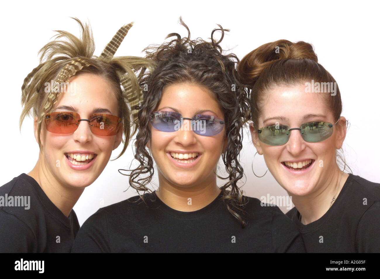 Three Models wearing tinted frameless glasses - Stock Image