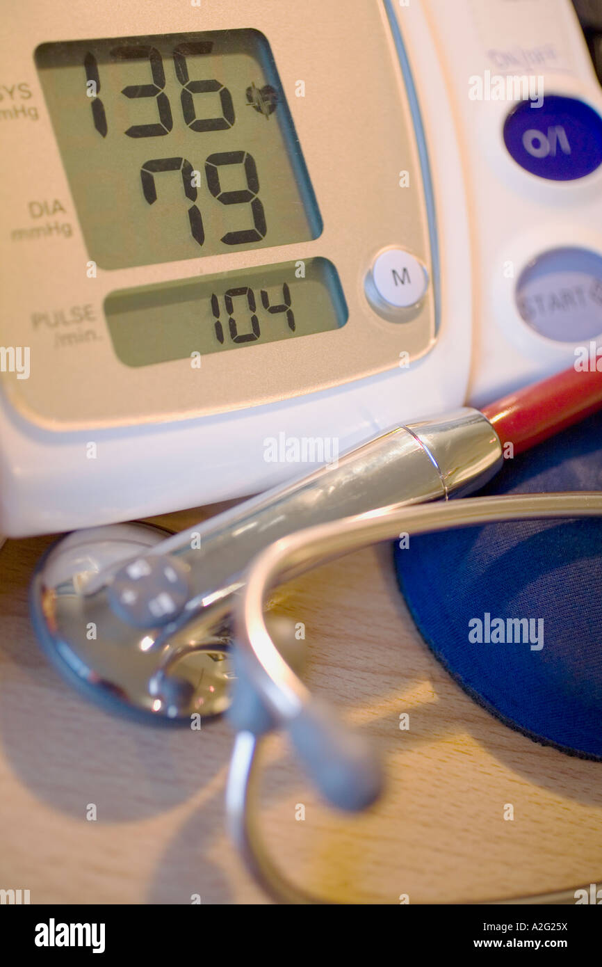 Electronic Sphygmomanometer scale and stethoscope close-up close up closeup macro photograph of medical instrument - Stock Image