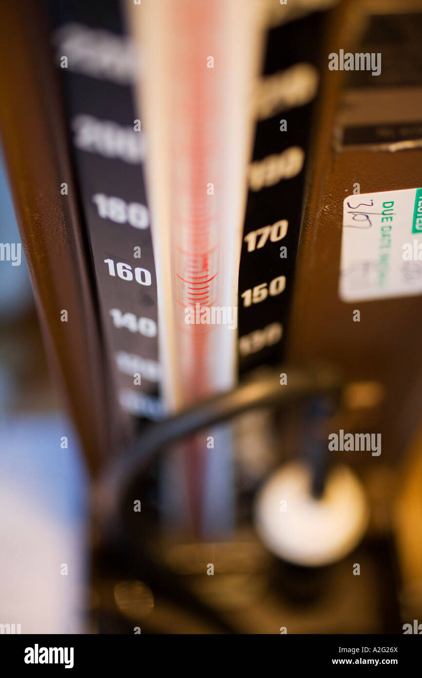 Sphygmomanometer machine scale close-up close up closeup macro photograph of medical instrument doctors measure - Stock Image