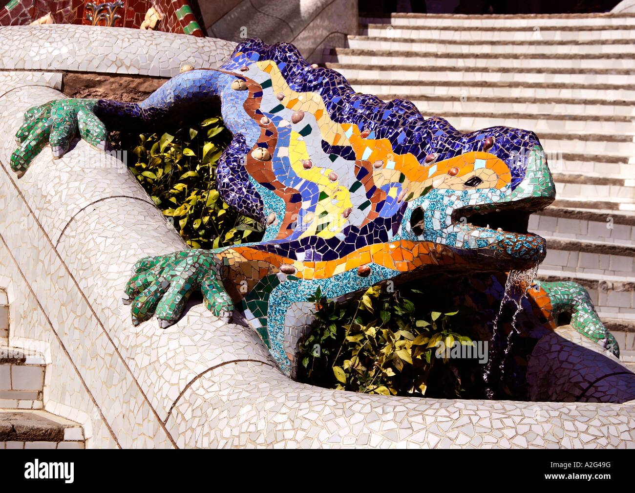 the much-photographed mosaic lizard in Park Guell, Barcelona, Spain - Stock Image