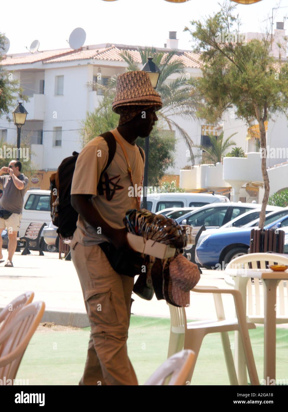 lookie lookie man working a beachside bar restaurant la cala de rh alamy com lookie lookie meaning lookie lookie man